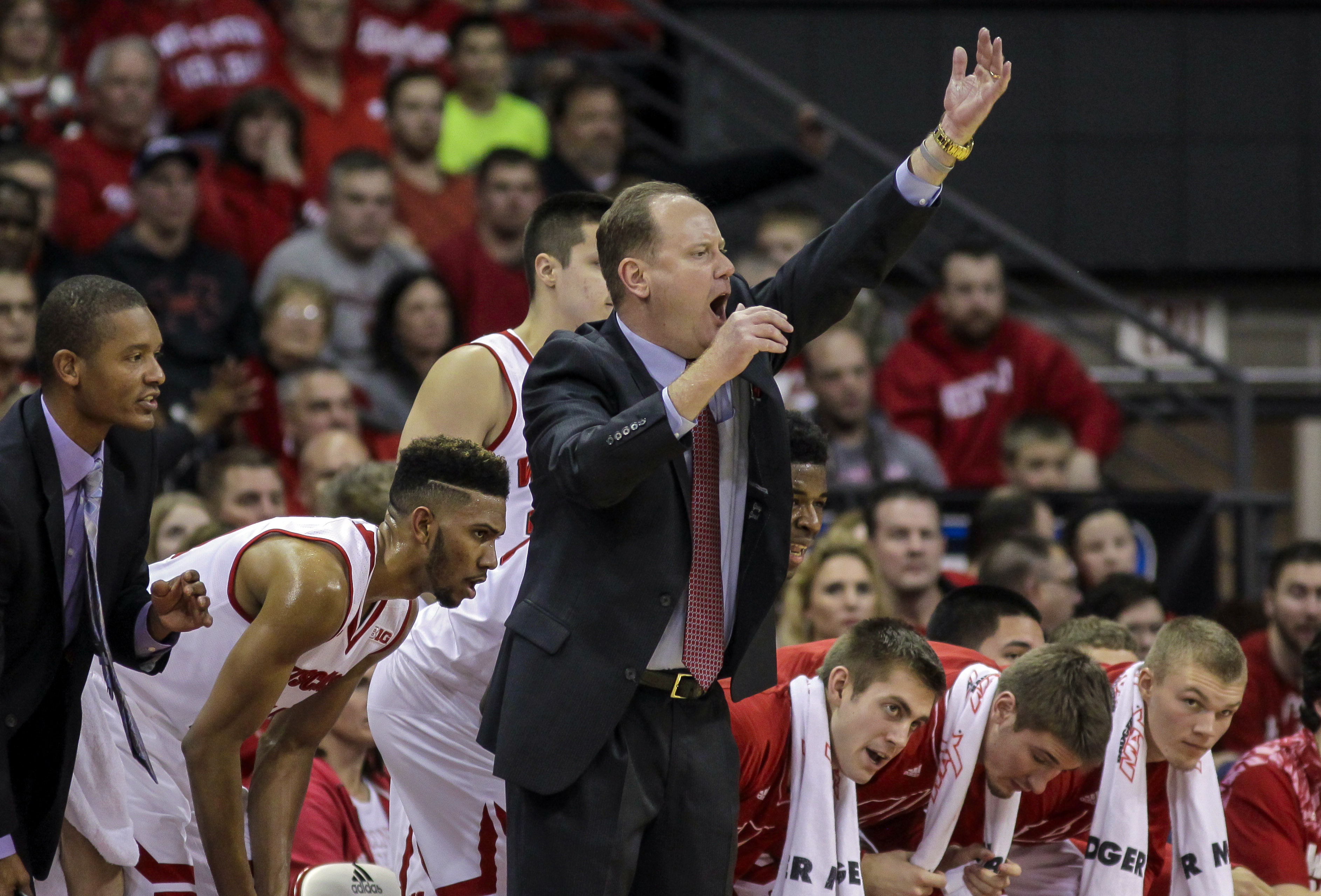 Wisconsin interim head coach Greg Gard yells to his team during the first half of an NCAA college basketball game against Green Bay Wednesday, Dec. 23, 2015, in Madison, Wis. (AP Photo/Andy Manis)