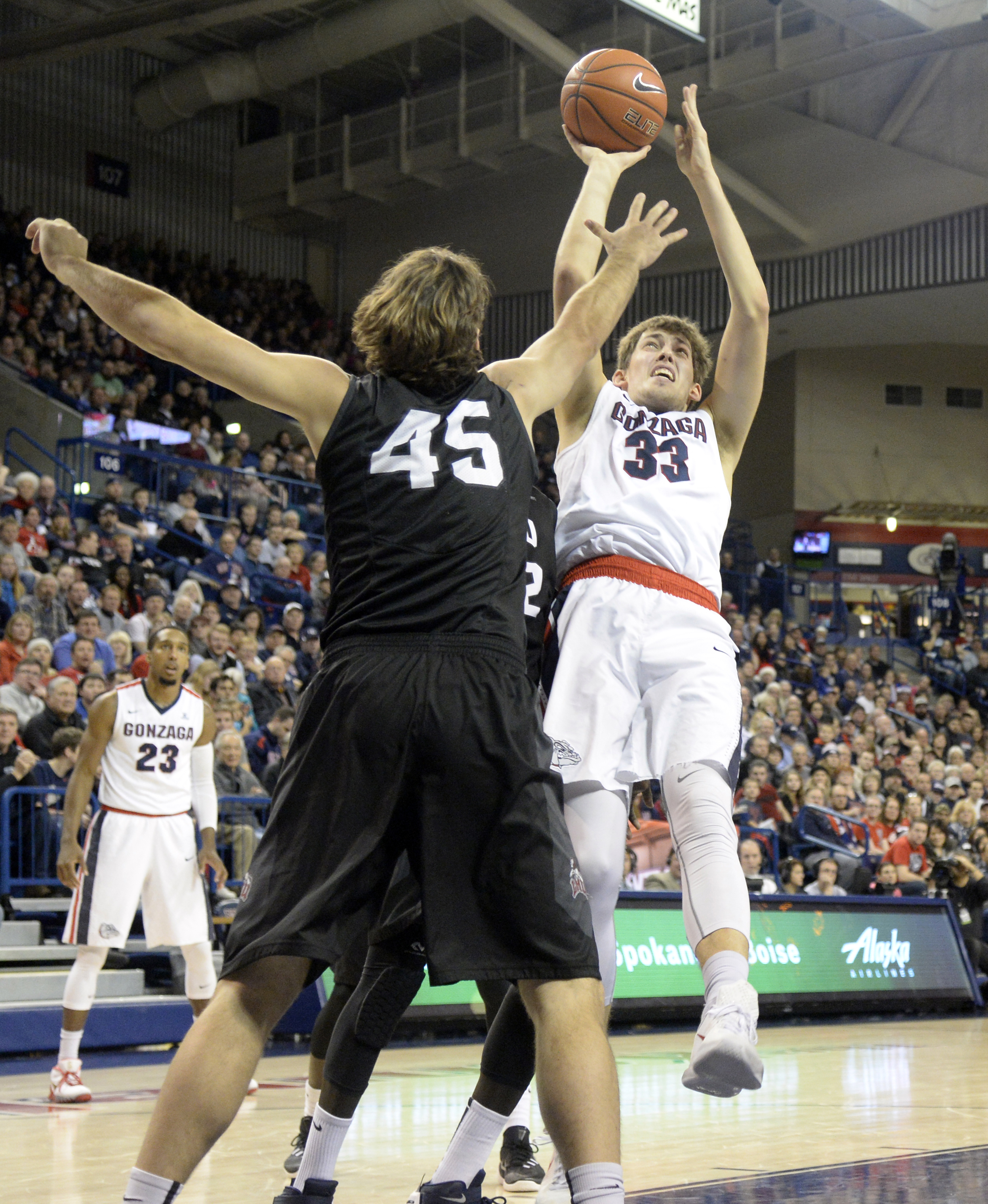 Gonzaga's Kyle Wiltjer tries a catch-and-shoot in the paint but is knocked off-balance by Loyola Marymount's David Humphries (45), drawing a foul, during the first half of an NCAA college basketball game Wednesday, Dec. 23, 2015, in Spokane, Wash. (Jesse