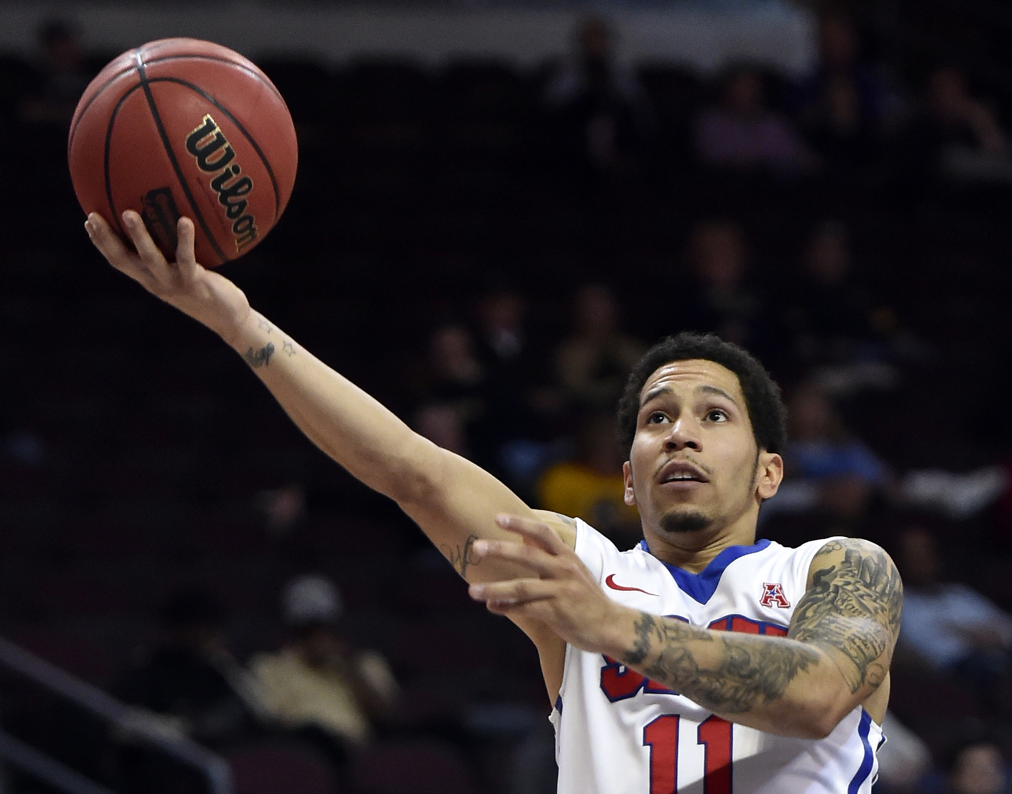 SMU guard Nic Moore shoots against Colorado during the first half of an NCAA college basketball game Wednesday, Dec. 23, 2015, in Las Vegas. (AP Photo/David Becker)