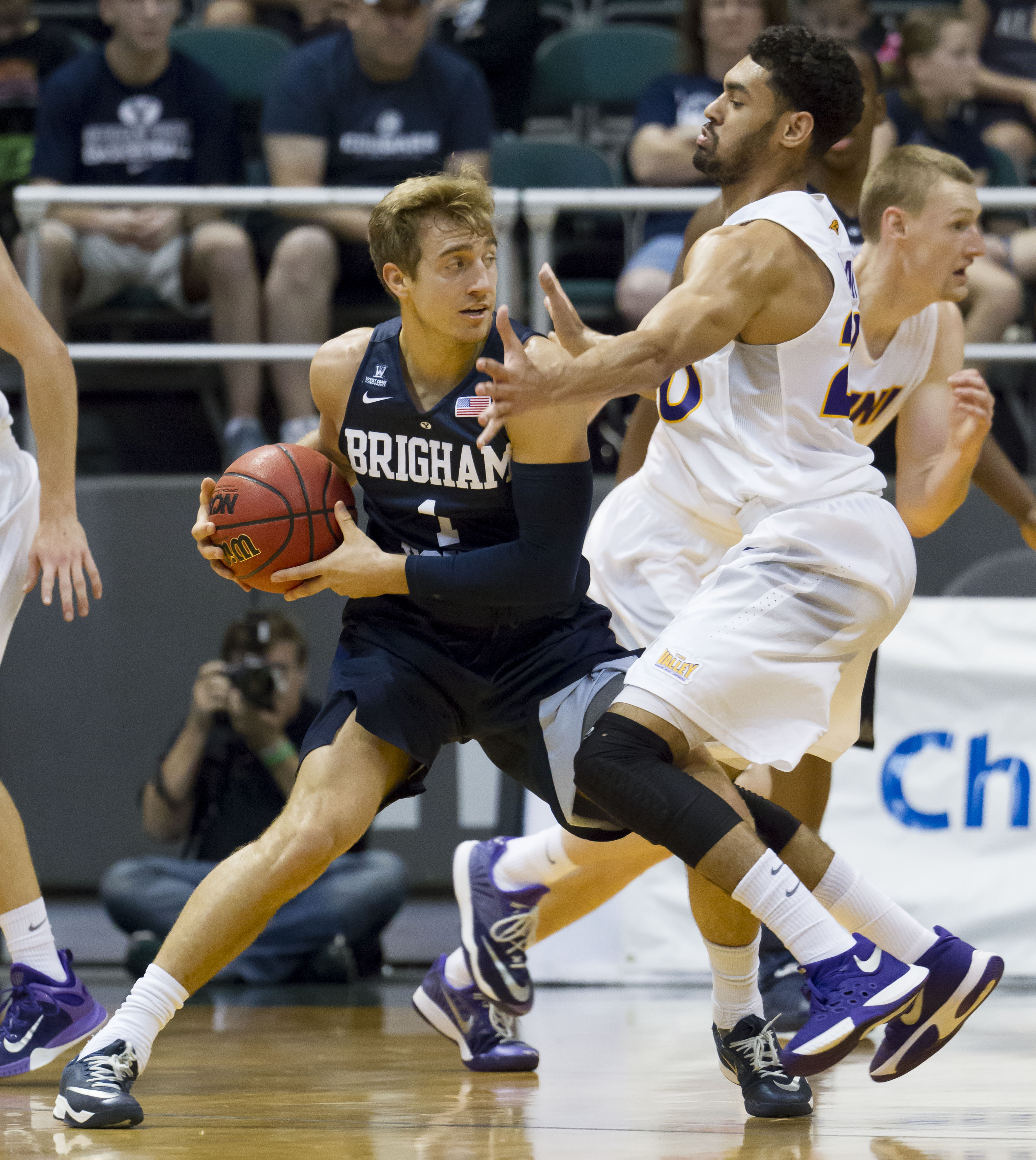 BYU guard Chase Fischer (1) looks for an open teammate to pass to while being defended by Northern Iowa guard Jeremy Morgan, right, in the second half of an NCAA college basketball game at the Diamond Head Classic, Friday, Dec. 25, 2015, in Honolulu. BYU