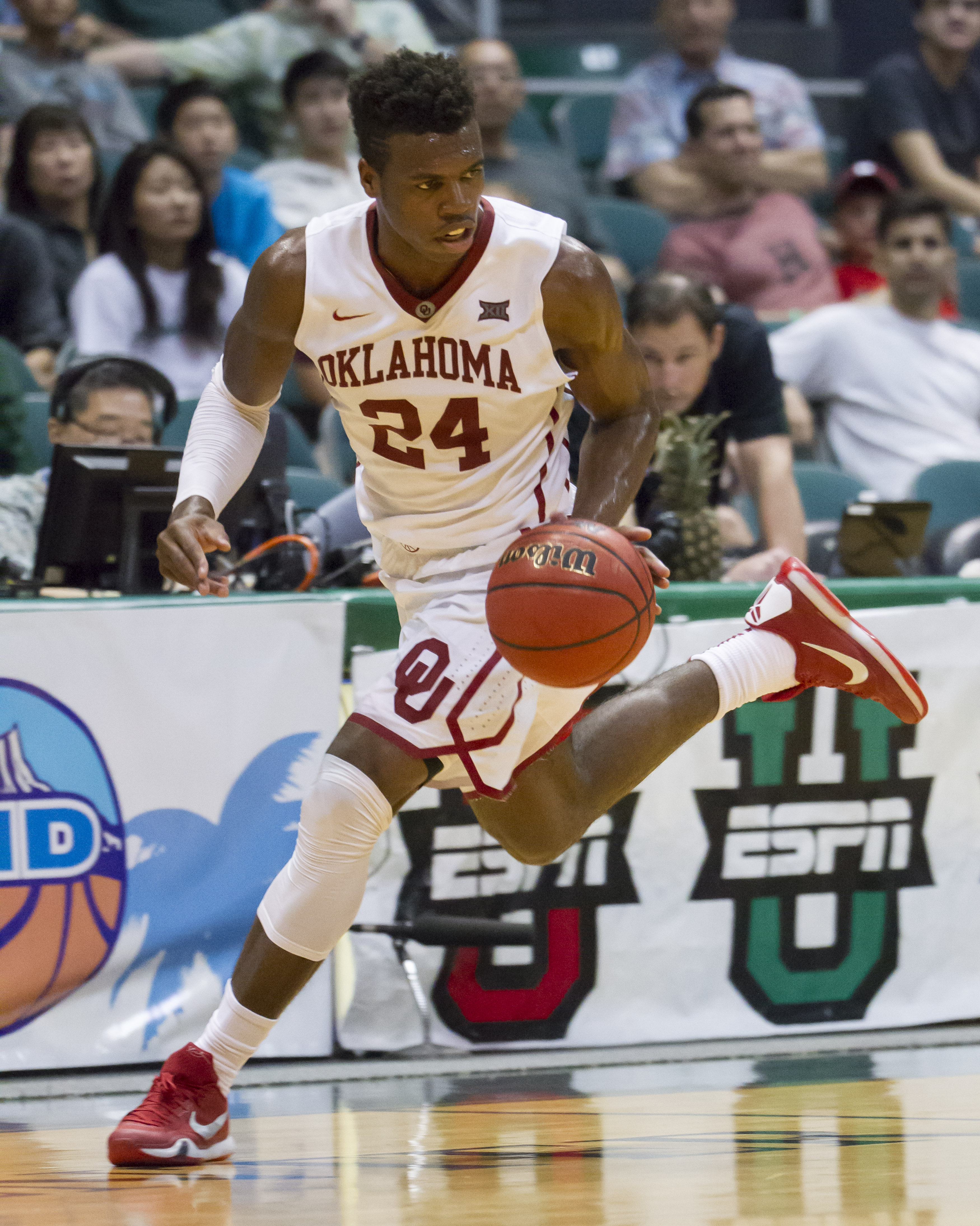 Oklahoma guard Buddy Hield (24) dribbles the basketball up court in the first half of an NCAA college basketball game against Harvard at the Diamond Head Classic, Friday, Dec. 25, 2015, in Honolulu. (AP Photo/Eugene Tanner)