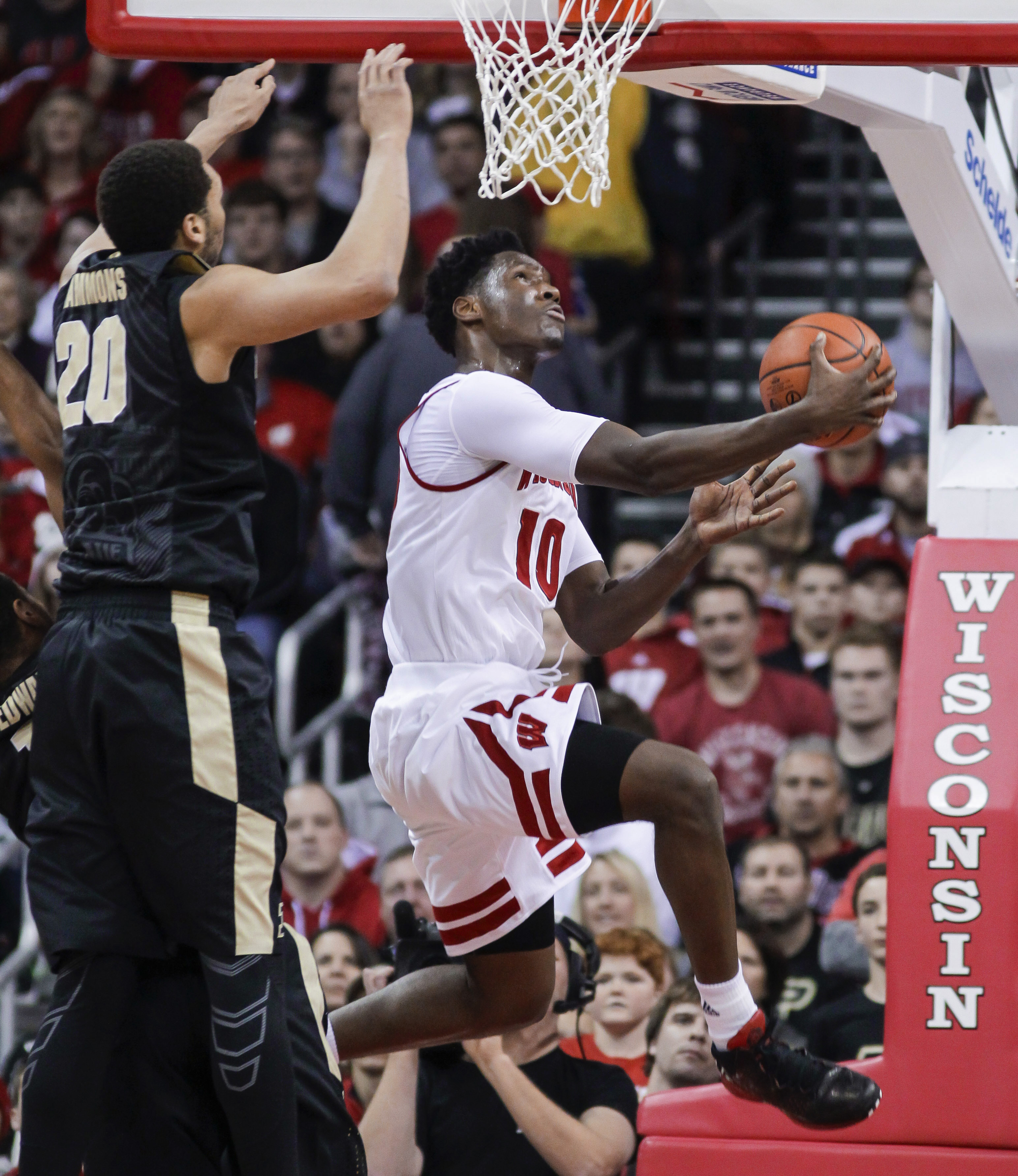 Wisconsin's Nigel Hayes (10) shoots against Purdue's A.J. Hammons (20) during the first half of an NCAA college basketball game Tuesday, Dec. 29, 2015, in Madison, Wis. (AP Photo/Andy Manis)