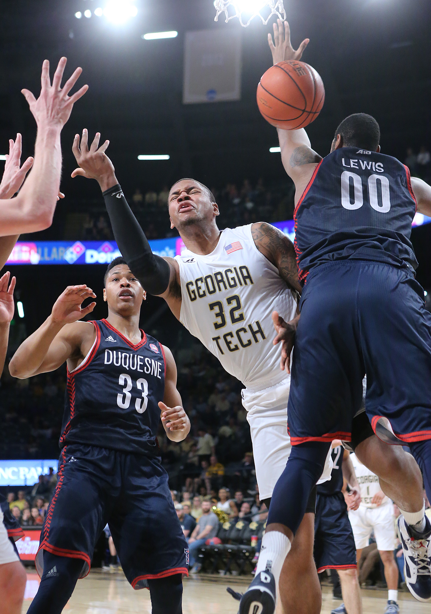 Duquesne center Darius Lewis defends against Georgia Tech forward Nick Jacobs during an NCAA college basketball game on Tuesday, Dec. 29, 2015, in Atlanta. (Curtis Compton/Atlanta Journal-Constitution via AP)  MARIETTA DAILY OUT; GWINNETT DAILY POST OUT;