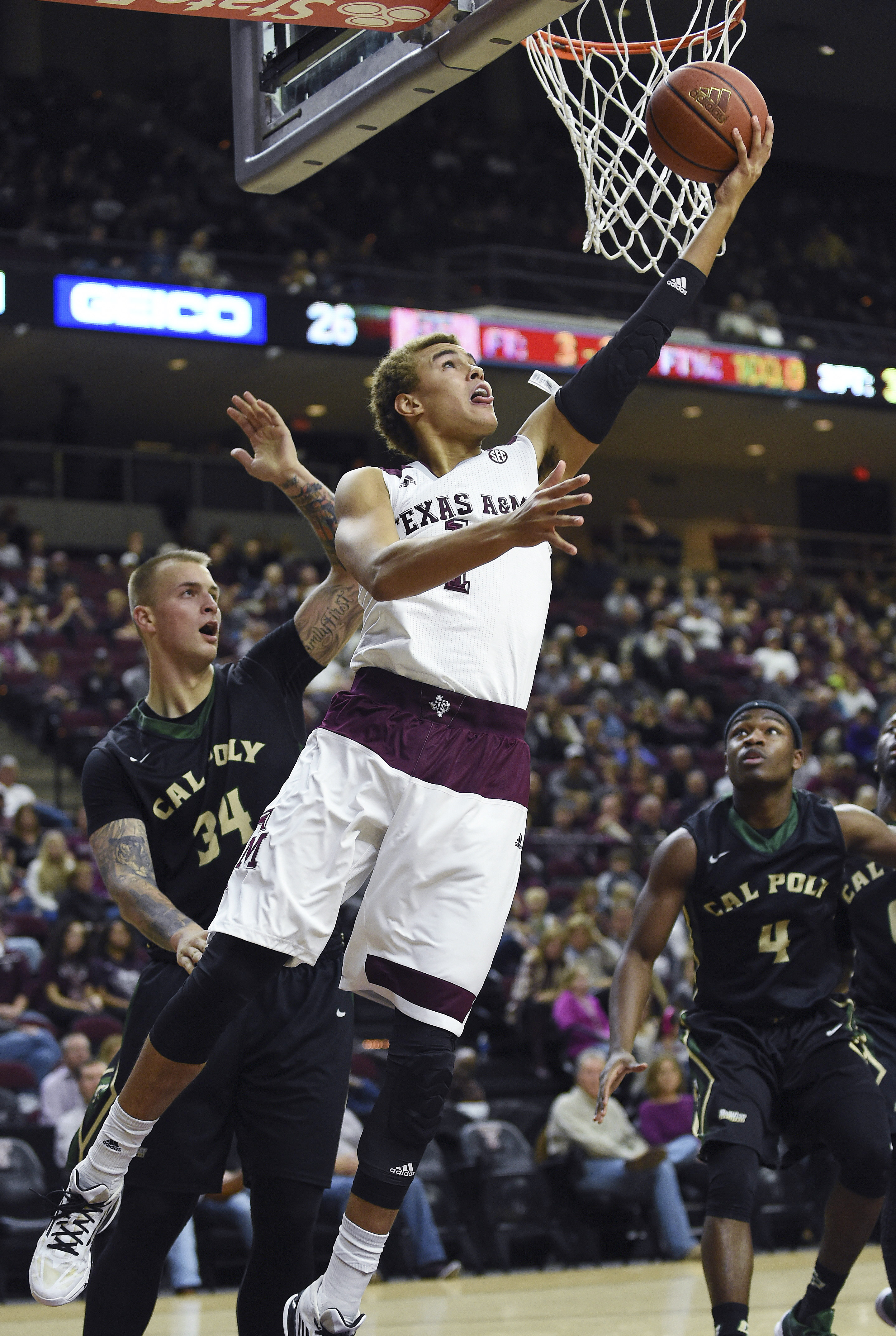 Texas A&M forward DJ Hogg (1) shoots past Cal Poly forward Brian Bennett (34) during the first half of an NCAA college basketball game Tuesday, Dec. 29, 2015, in College Station, Texas. (AP Photo/Eric Christian Smith)
