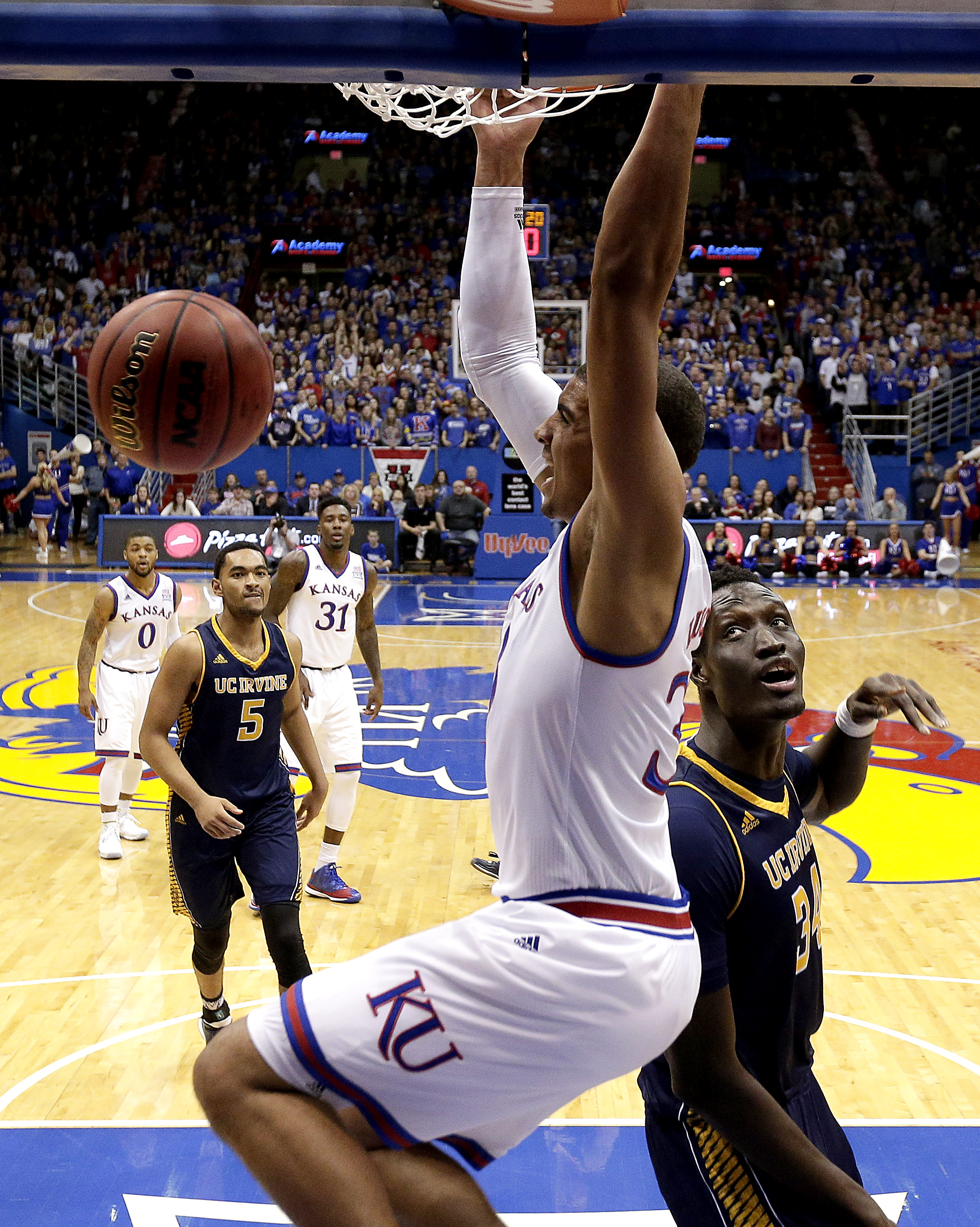 Kansas' Landen Lucas gets past UC Irvine's Mamadou Ndiaye (34) to dunk the ball during the first half of an NCAA college basketball game Tuesday, Dec. 29, 2015, in Lawrence, Kan. (AP Photo/Charlie Riedel)