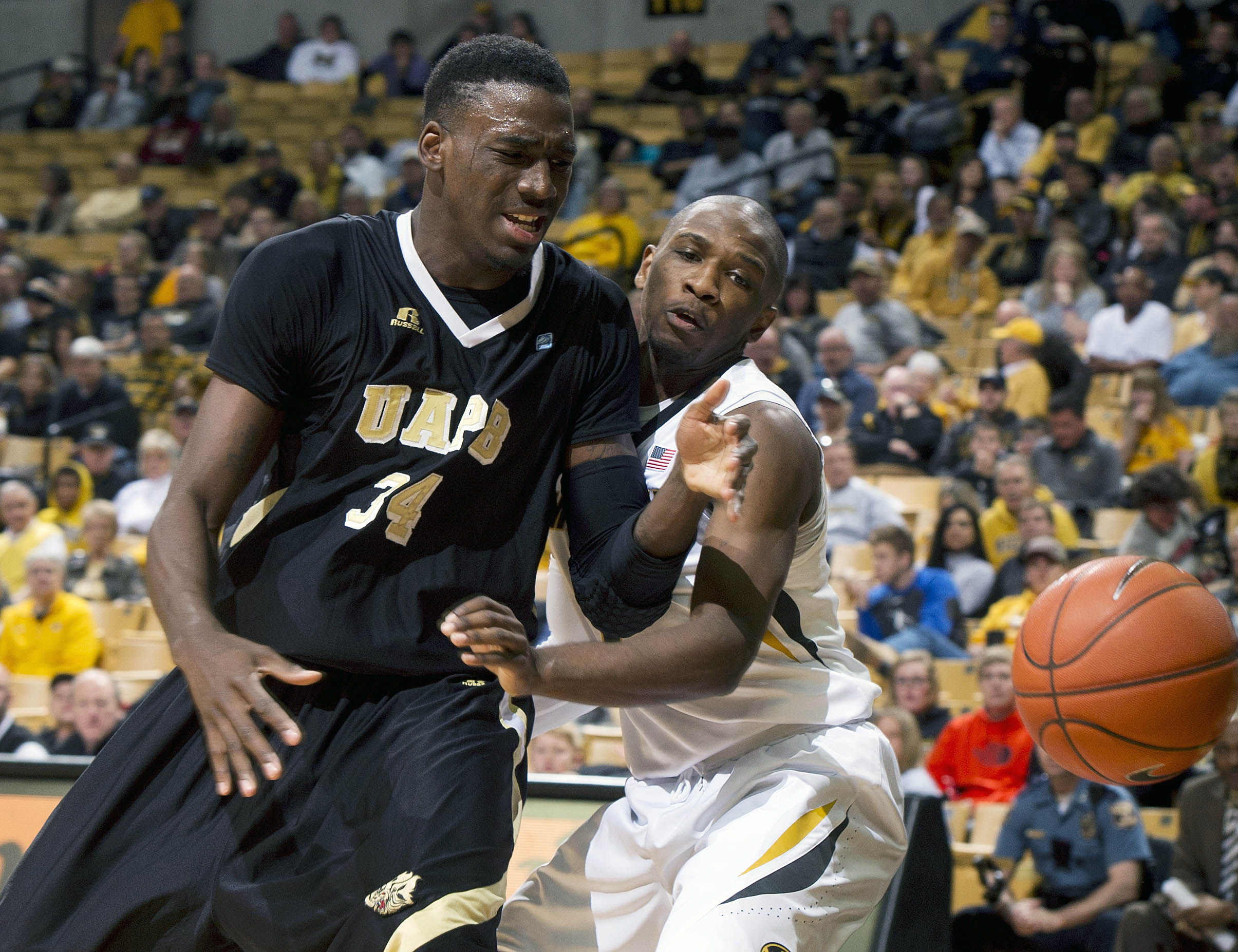 Missouri's Terrence Phillips, right, knocks the ball away from Arkansas-Pine Bluff's Devin Berry, right, during the second half of an NCAA college basketball game, Tuesday, Dec. 29, 2015, in Columbia, Mo. Missouri won the game 78-25. (AP Photo/L.G. Patter