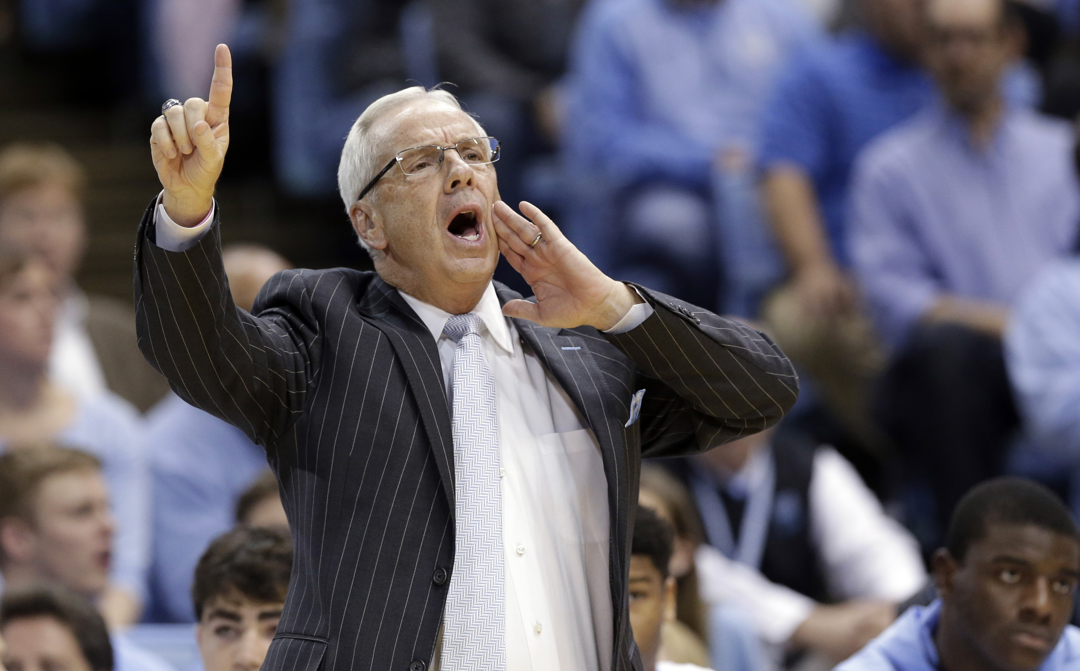 FILE - In this Dec. 1, 2015, file photo, North Carolina coach Roy Williams directs his team during the first half of an NCAA college basketball game against Maryland in Chapel Hill, N.C.  Williams' No. 7 Tar Heels were ranked No. 1 nationally and entered