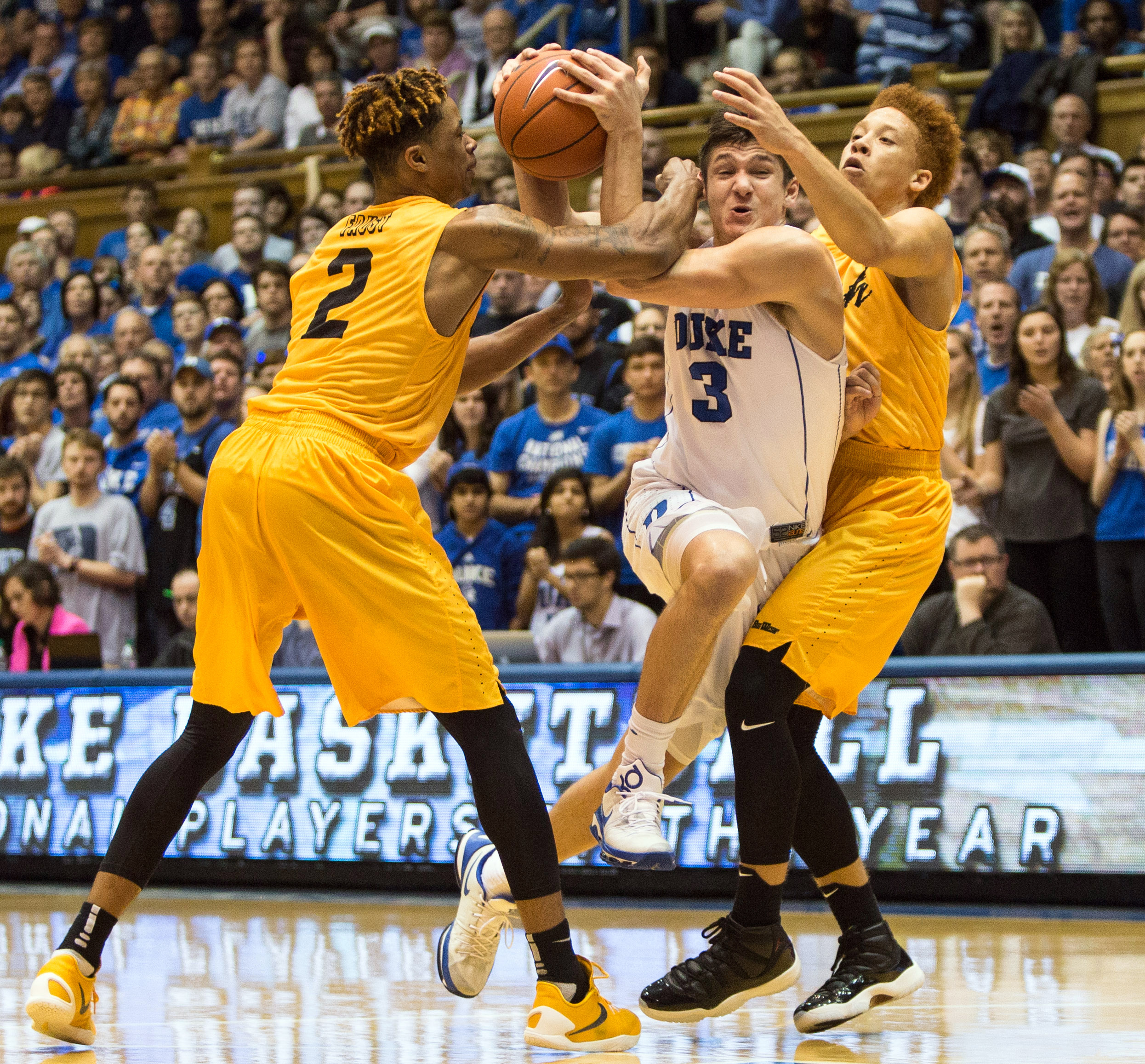 Duke's Grayson Allen (3) drives between Long Beach State's Nick Faust (2) and Noah Blackwell (3) during the first half of an NCAA college basketball game in Durham, N.C., Wednesday, Dec. 30, 2015. (AP Photo/Ben McKeown)