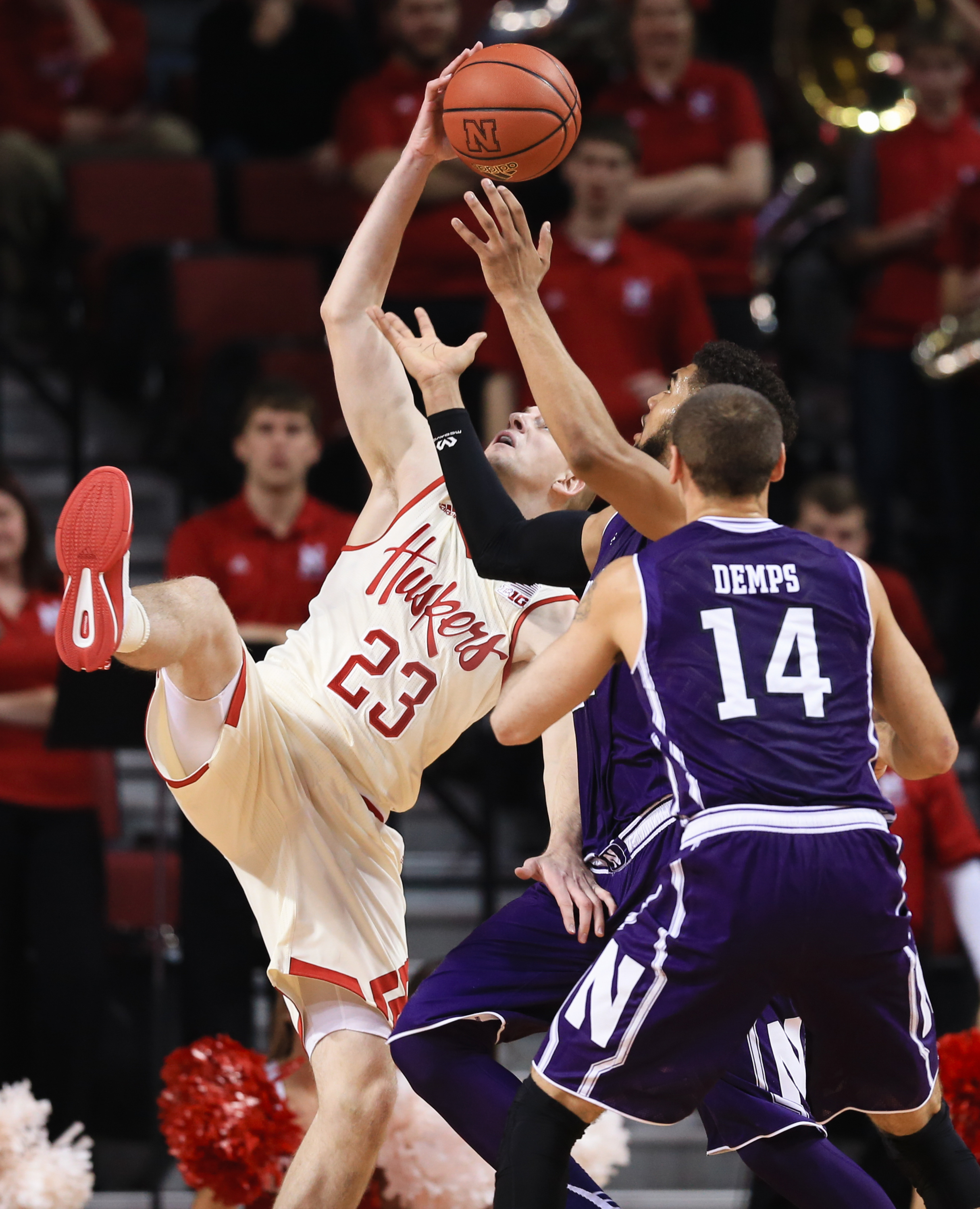 Nebraska's Nick Fuller (23) goes for a rebound against Northwestern's Sanjay Lumpkin (34) and Tre Demps (14) during the first half of an NCAA college basketball game in Lincoln, Neb., Wednesday, Dec. 30, 2015. (AP Photo/Nati Harnik)