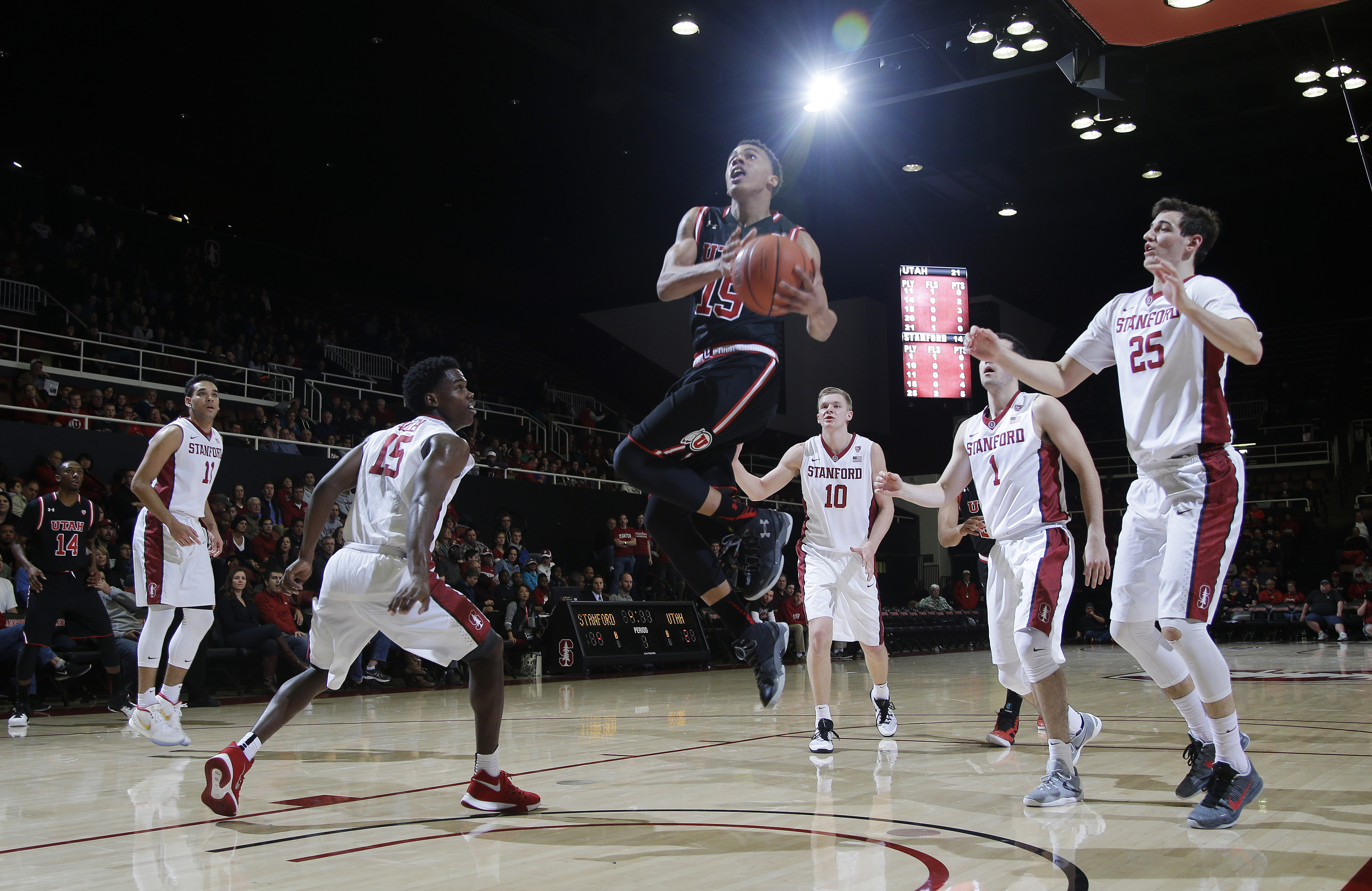 Utah guard Lorenzo Bonam (15) drives to the basket against Stanford during the first half of an NCAA college basketball game Friday, Jan. 1, 2016, in Stanford, Calif. (AP Photo/Marcio Jose Sanchez)