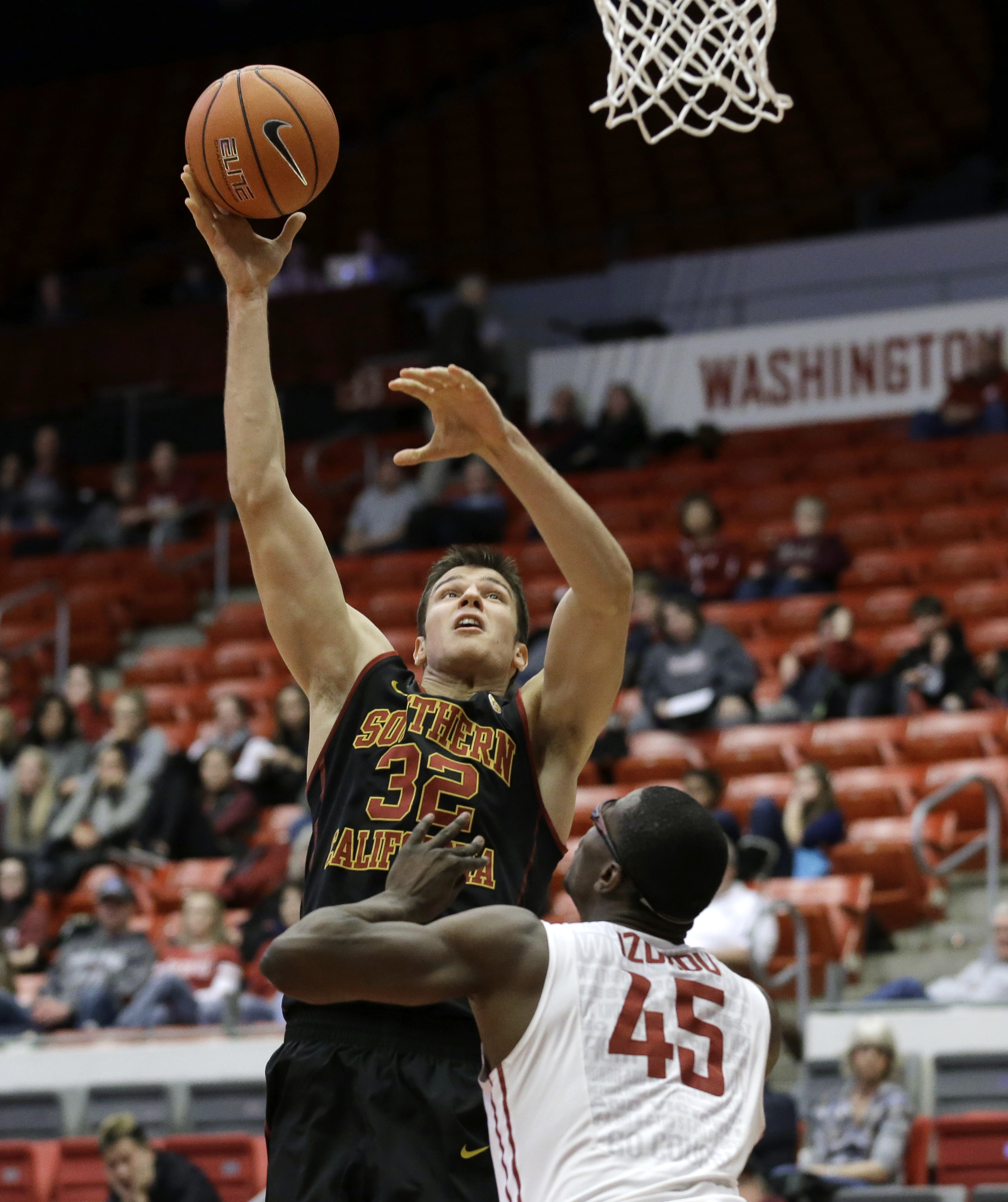 Southern California forward Nikola Jovanovic puts up a shot over Washington State center Valentine Izundu (45) in the second half of an NCAA college basketball game, Friday, Jan. 1, 2016, in Pullman, Wash. Jovanovic had 20 points as to lead Southern Calif