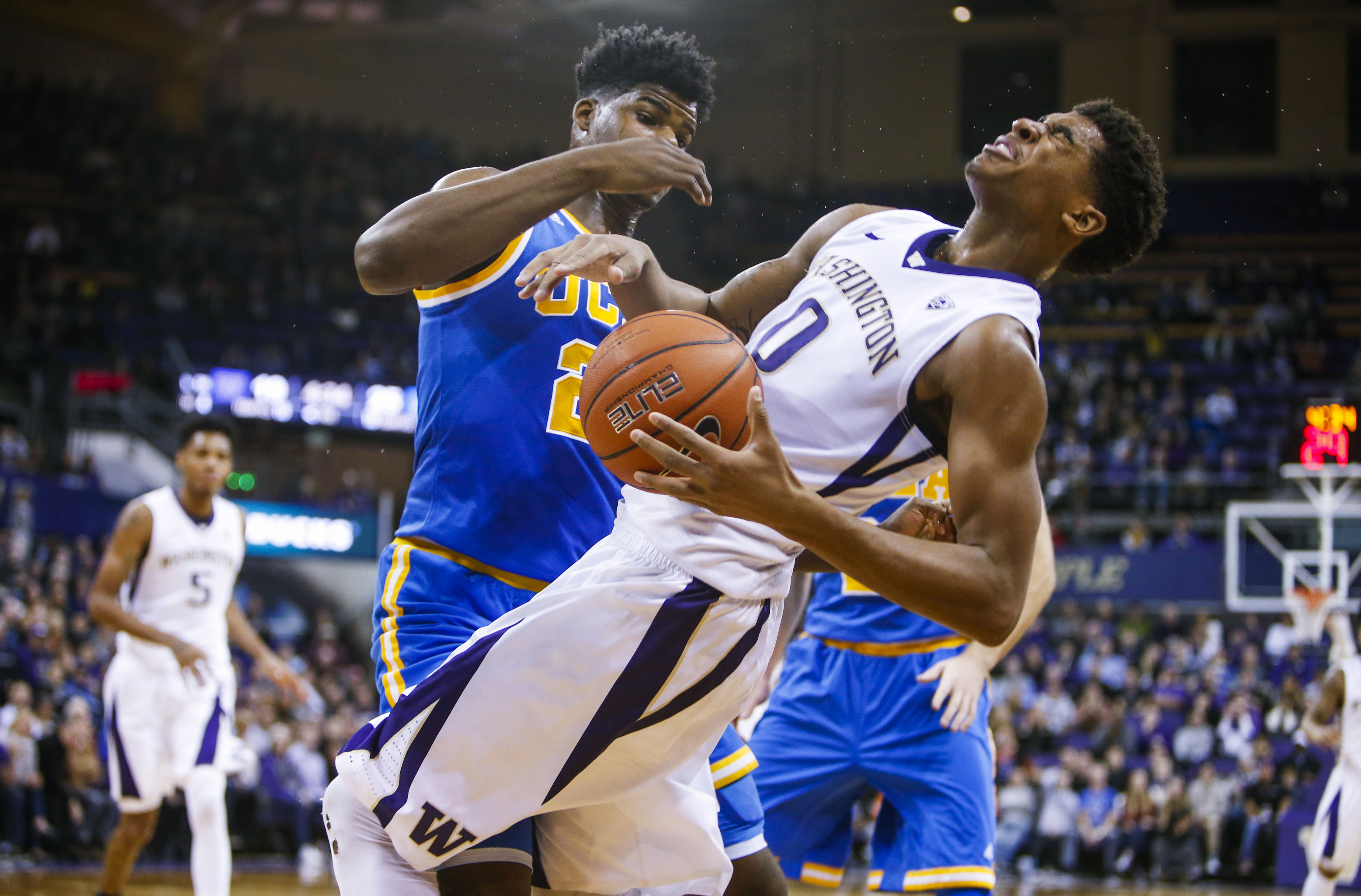 Washington forward Marquese Chriss (0) reacts after being fouled by UCLA forward Tony Parker (23) during the first half of an NCAA college basketball game Friday, Jan. 1, 2016, in Seattle. (AP Photo/Joe Nicholson)