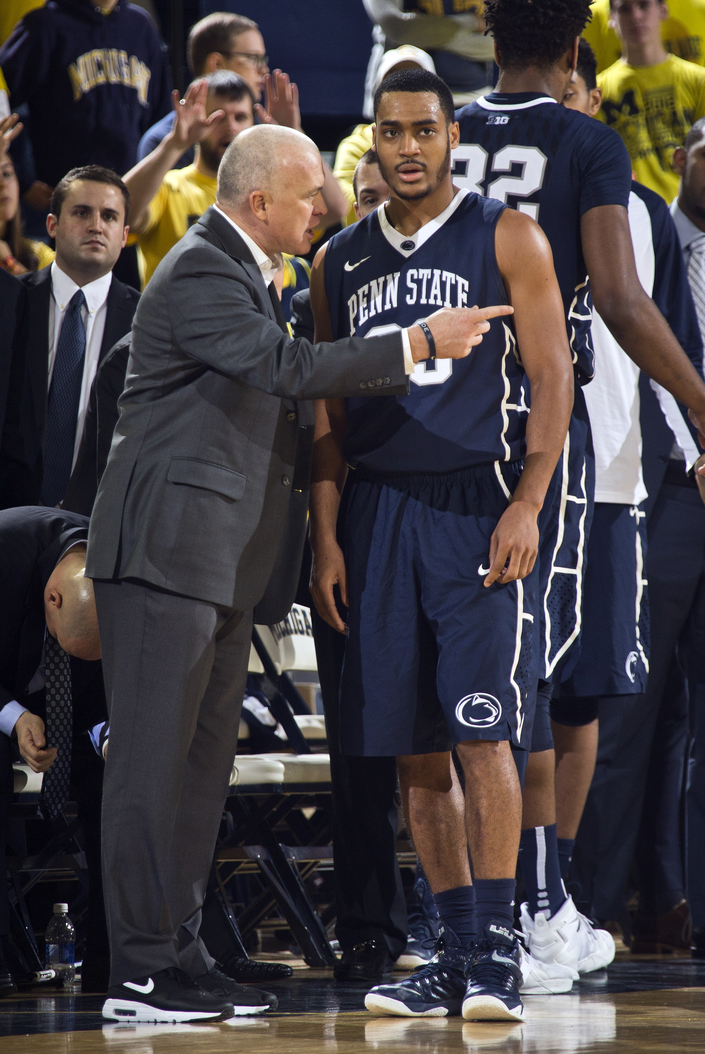Penn State head coach Patrick Chambers, left, gives instructions to guard Shep Garner (33) during a timeout in the second half of an NCAA college basketball game against Michigan at Crisler Center in Ann Arbor, Mich., Saturday, Jan. 2, 2016. Michigan won