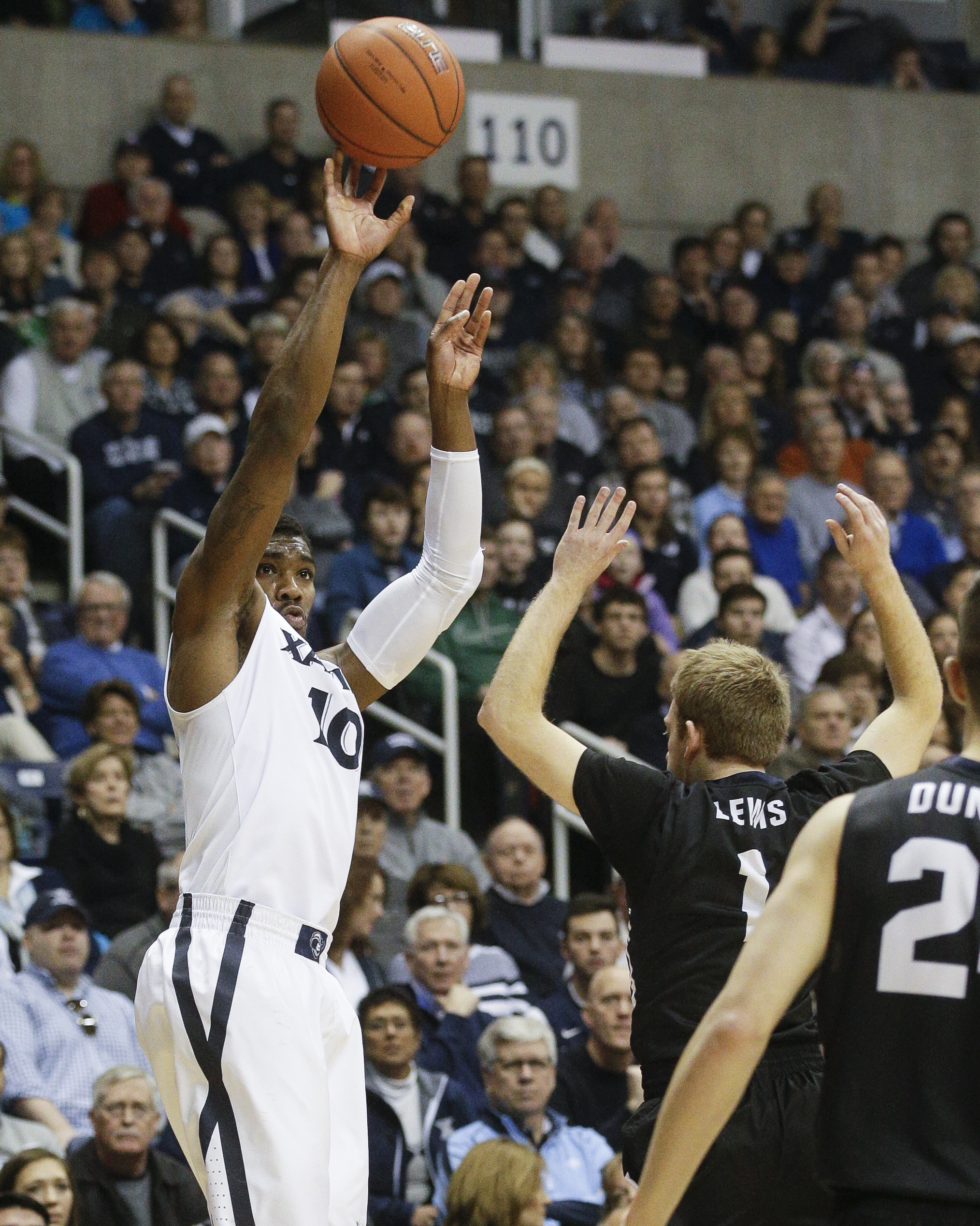 Xavier's Remy Abell (10) shoots over Butler's Tyler Lewis (1) in the first half of an NCAA college basketball game, Saturday, Jan. 2, 2016, in Cincinnati. (AP Photo/John Minchillo)