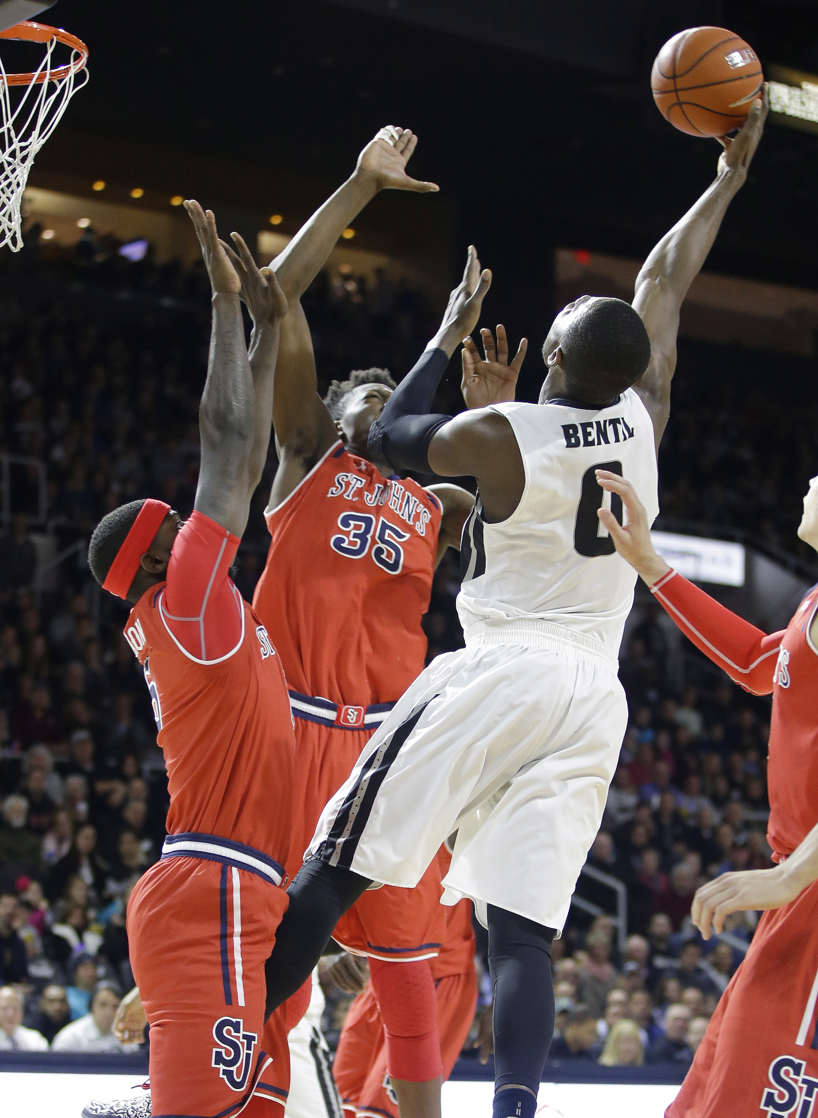 Providence forward Ben Bentil (0) shoots over St. John's center Yankuba Sima (35) and forward Durand Johnson (5) during the first half of an NCAA college basketball game, Saturday, Jan. 2, 2016, in Providence, R.I. (AP Photo/Stephan Savoia)