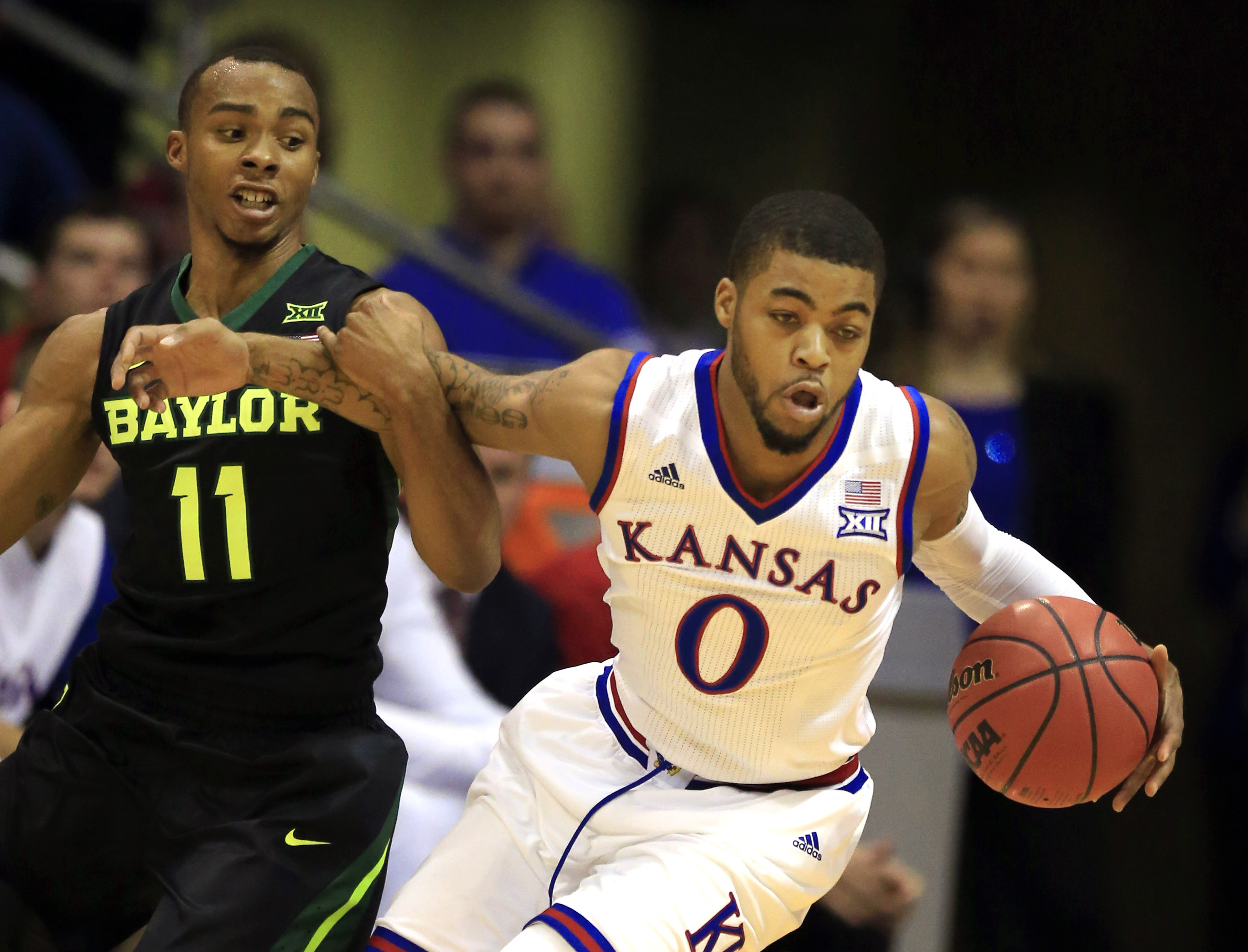 Kansas guard Frank Mason III (0) breaks away from Baylor guard Lester Medford (11) during the first half of an NCAA college basketball game in Lawrence, Kan., Saturday, Jan. 2, 2016. (AP Photo/Orlin Wagner)