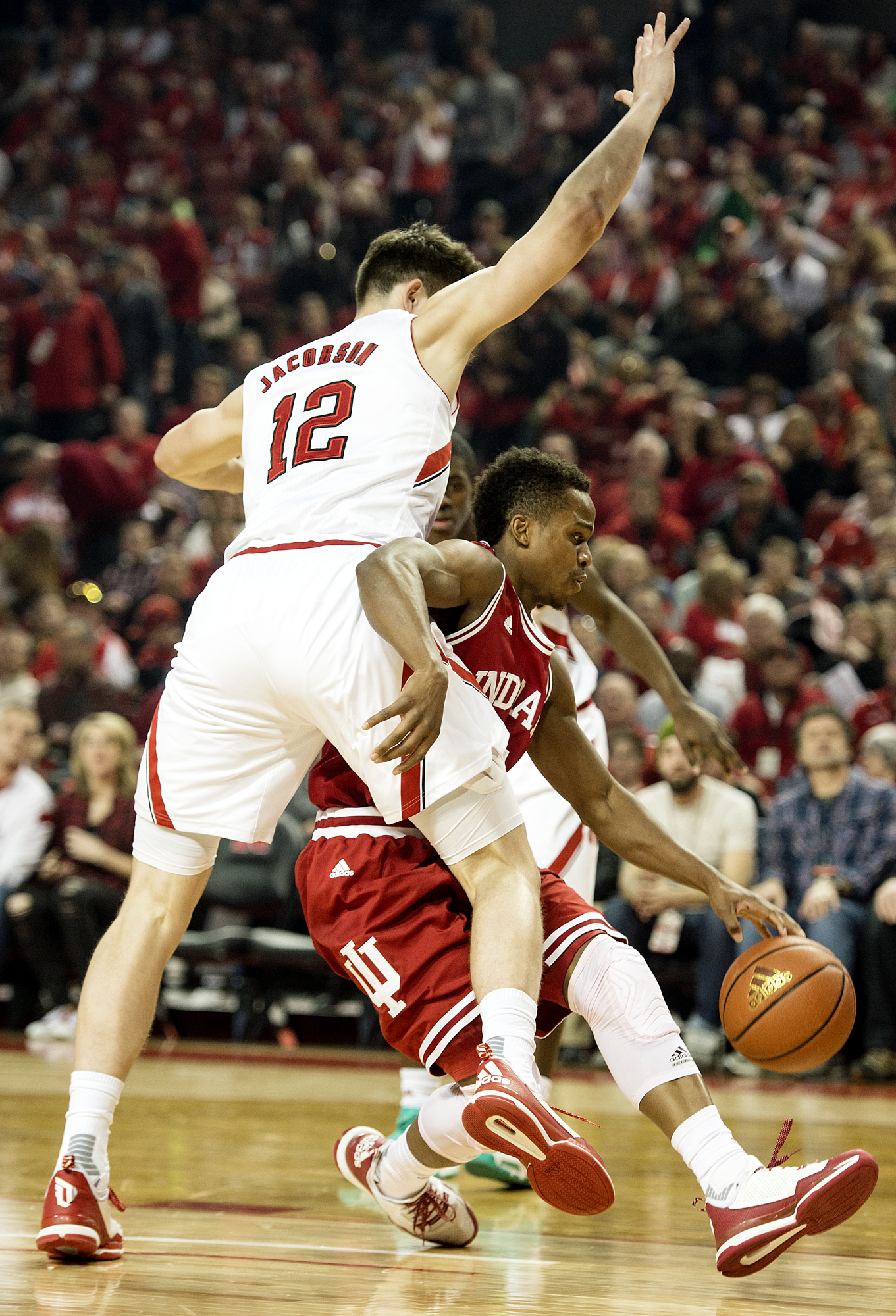 Indiana guard Yogi Ferrell (11) tries to drive under Nebraska forward Michael Jacobson (12) during the first half of an NCAA college basketball game, Saturday, Jan. 2, 2016, at Pinnacle Bank Arena in Lincoln, Neb. (Kristin Streff/The Journal-Star via AP)