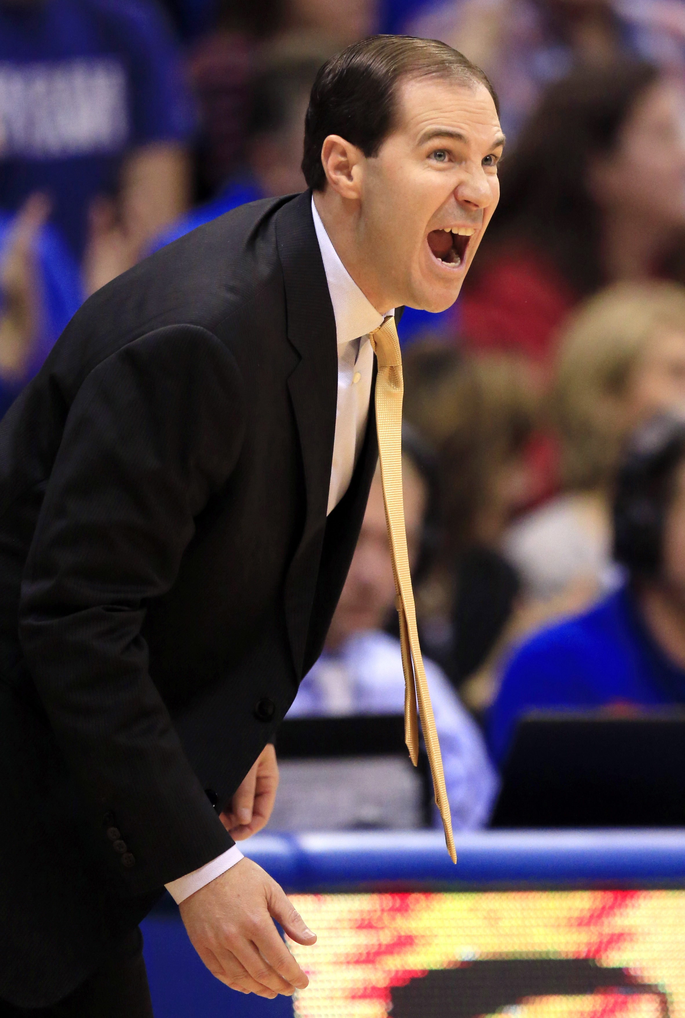 Baylor head coach Scott Drew yells to his team during the first half of an NCAA college basketball game against Kansas in Lawrence, Kan., Saturday, Jan. 2, 2016. (AP Photo/Orlin Wagner)