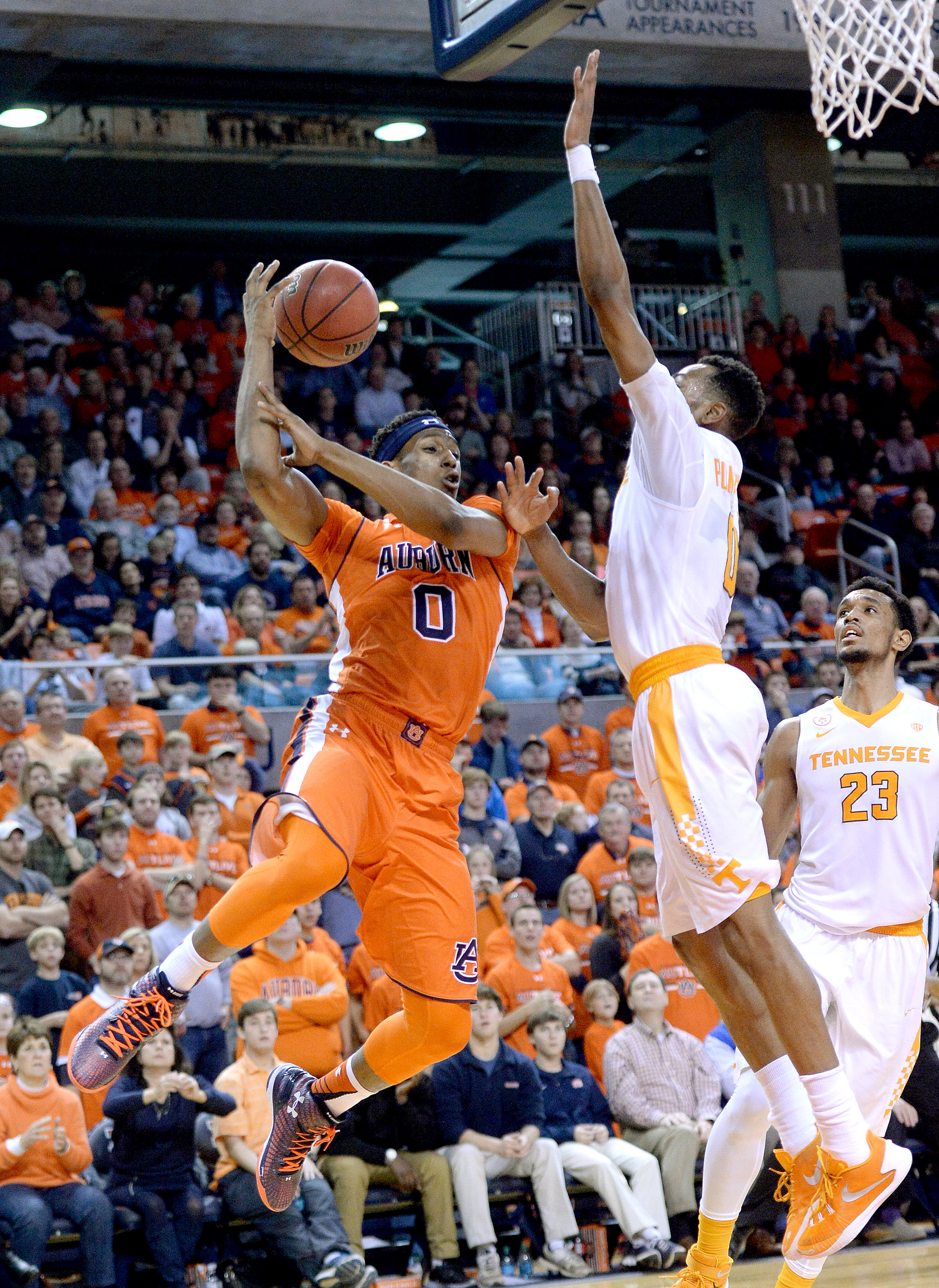Tennessee guard Kevin Punter (0) fouls Auburn forward Horace Spencer (0) during the second half of an NCAA college basketball game, Saturday, Jan. 2, 2016, in Auburn, Ala. (Julie Bennett /AL.com via AP) MAGS OUT; MANDATORY CREDIT