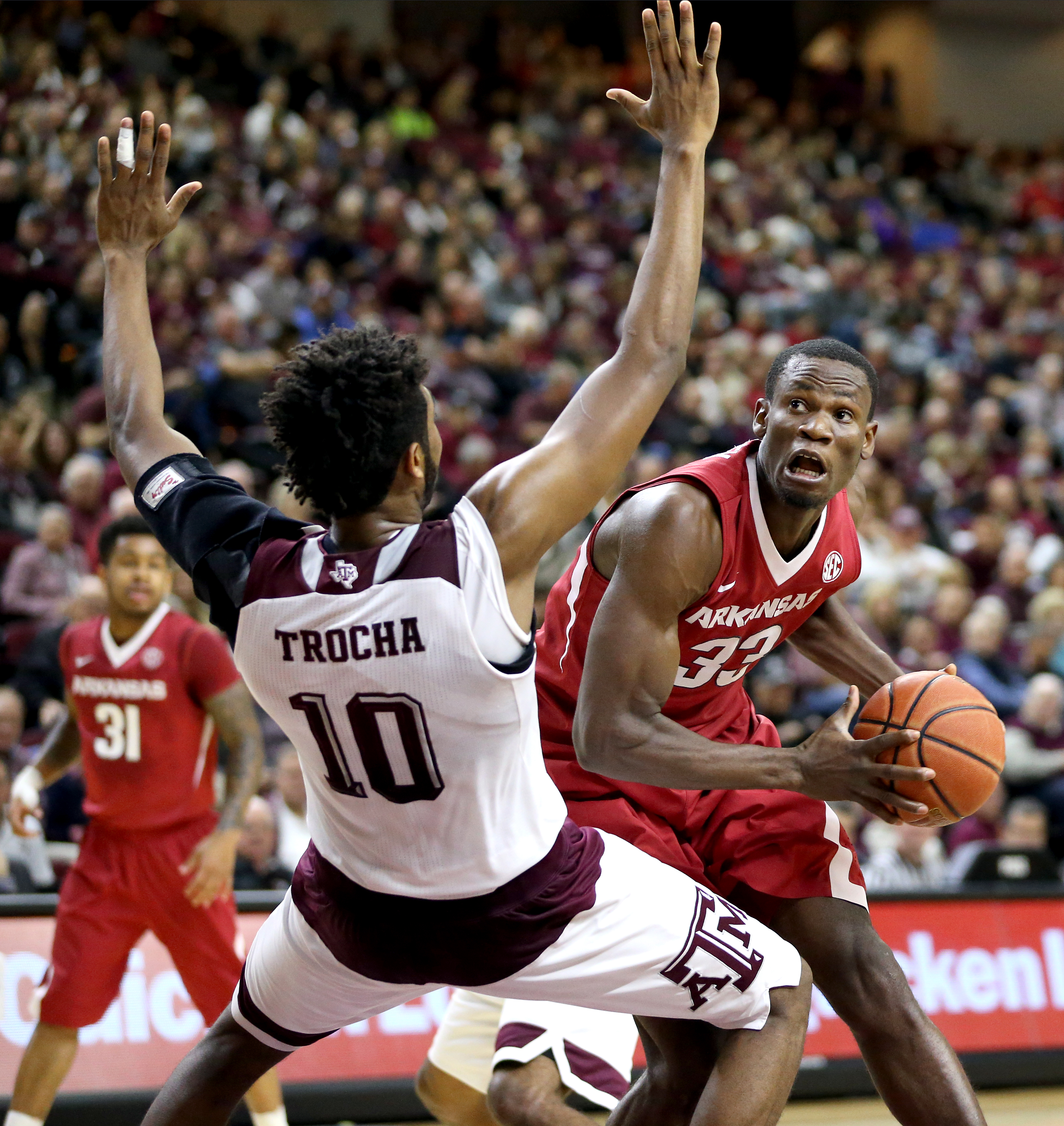 Arkansas' Moses Kingsley (33) drives the lane for a basket against Texas A&M's Tonny Trocha-Morelos (10) during the first half of an NCAA college basketball game Saturday, Jan. 2, 2016, in College Station,Texas. (AP Photo/Sam Craft)