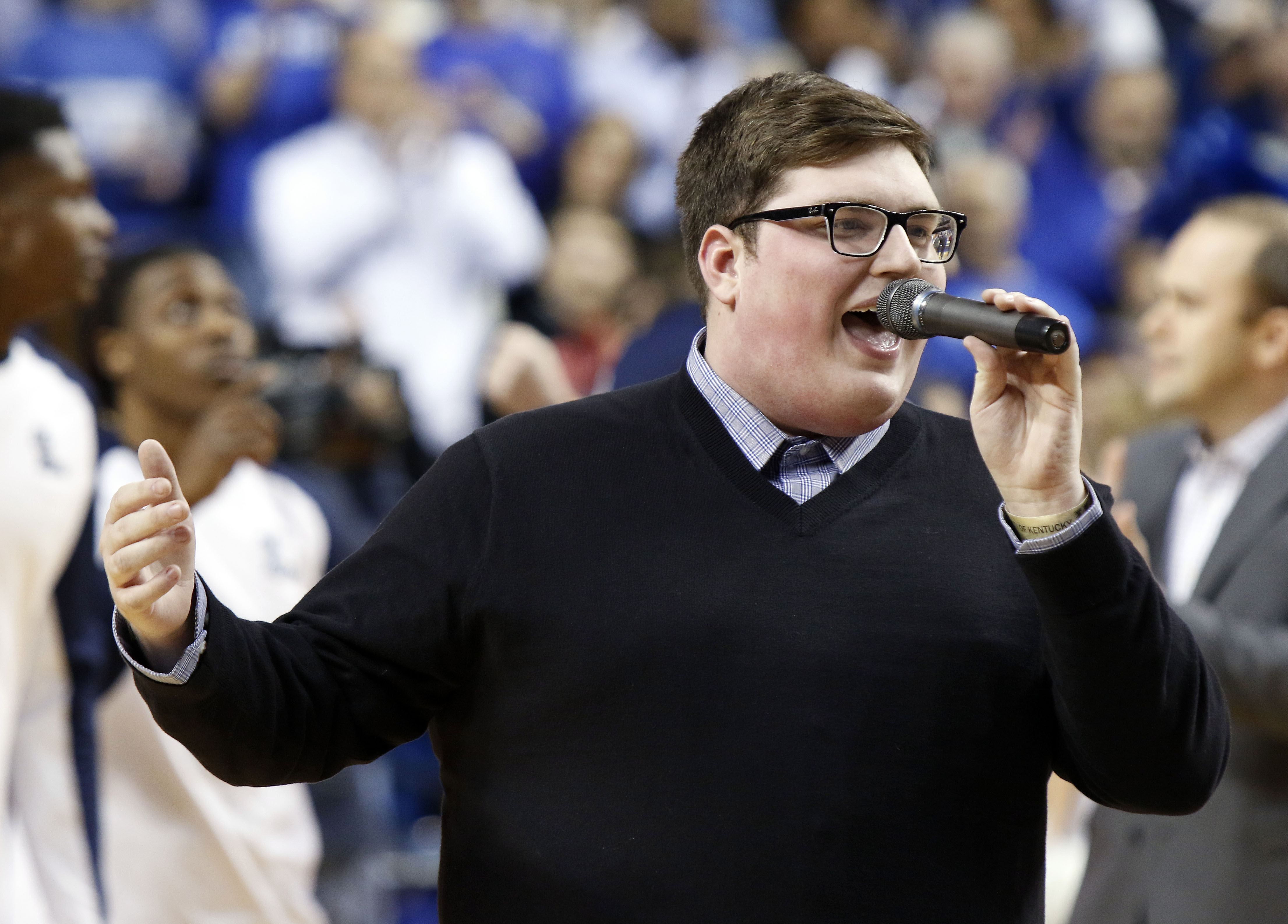 Kentucky native Jordan Smith, winner of The Voice, sings the National Anthem before an NCAA college basketball game between Kentucky and Mississippi Saturday, Jan. 2, 2016, in Lexington, Ky. (AP Photo/James Crisp)