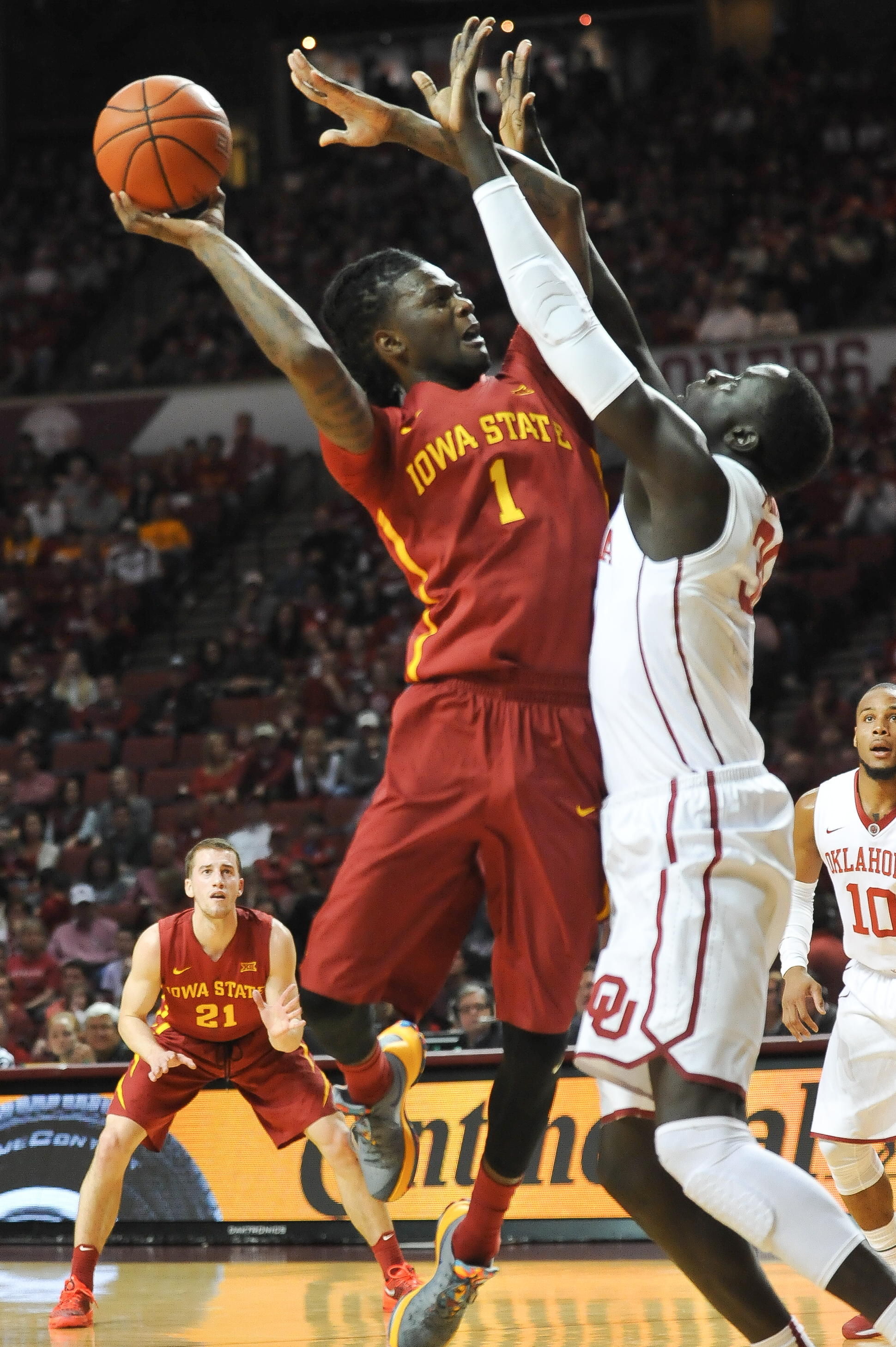 Iowa State forward Simeon Carter (1) shoots over Oklahoma center Akolda Manyang (30) during the first half of an NCAA college basketball game in Norman, Okla., Saturday, Jan. 2, 2016.  (AP Photo/Kyle Phillips)