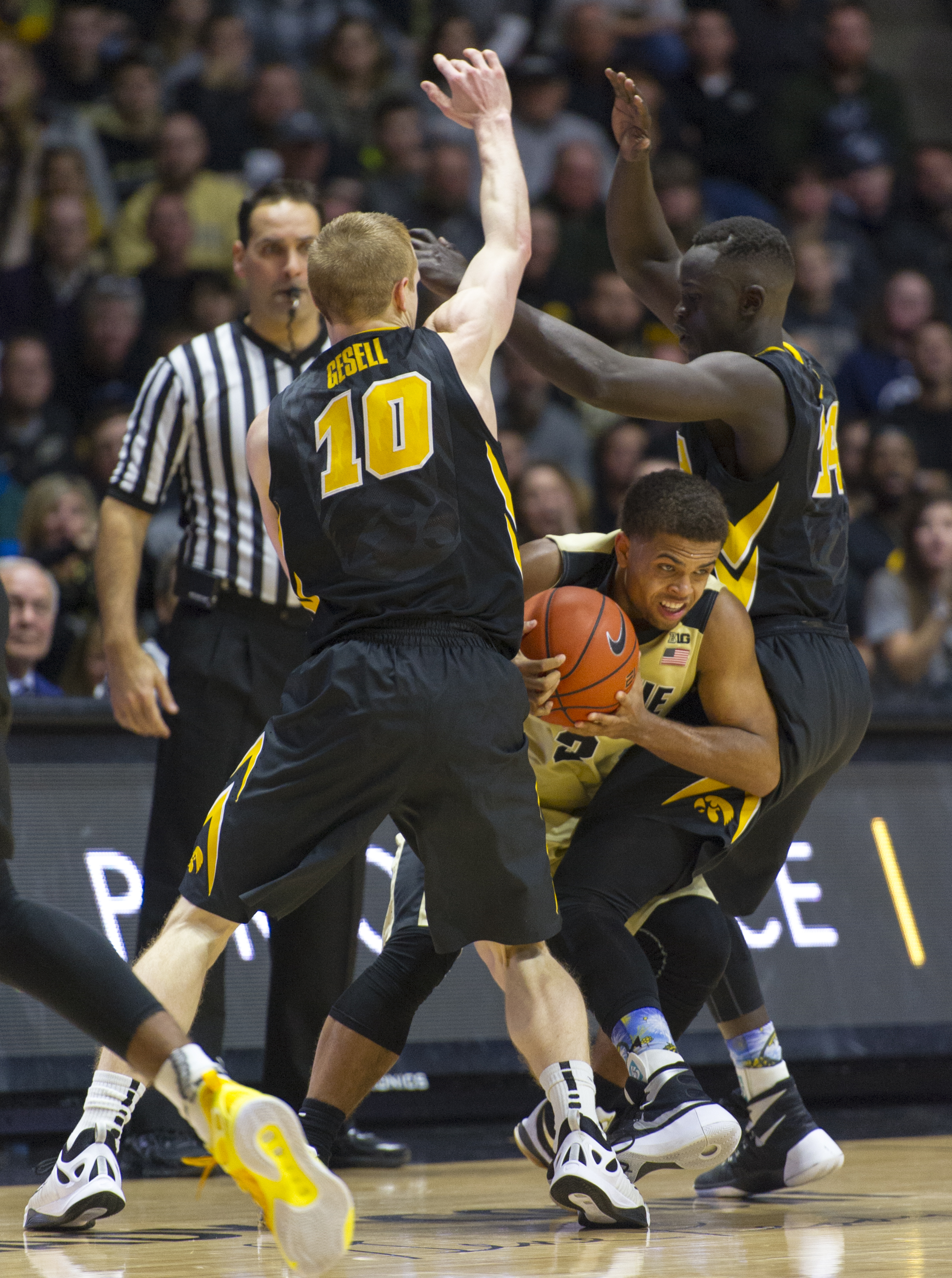 Purdue guard P.J. Thompson, center, is trapped by Iowa guard Mike Gesell, left, and guard Peter Jok, right, during the second half of an NCAA college basketball game, Jan. 2, 2016, in West Lafayette, Ind. Iowa won 70-63. (AP Photo/Doug McSchooler)