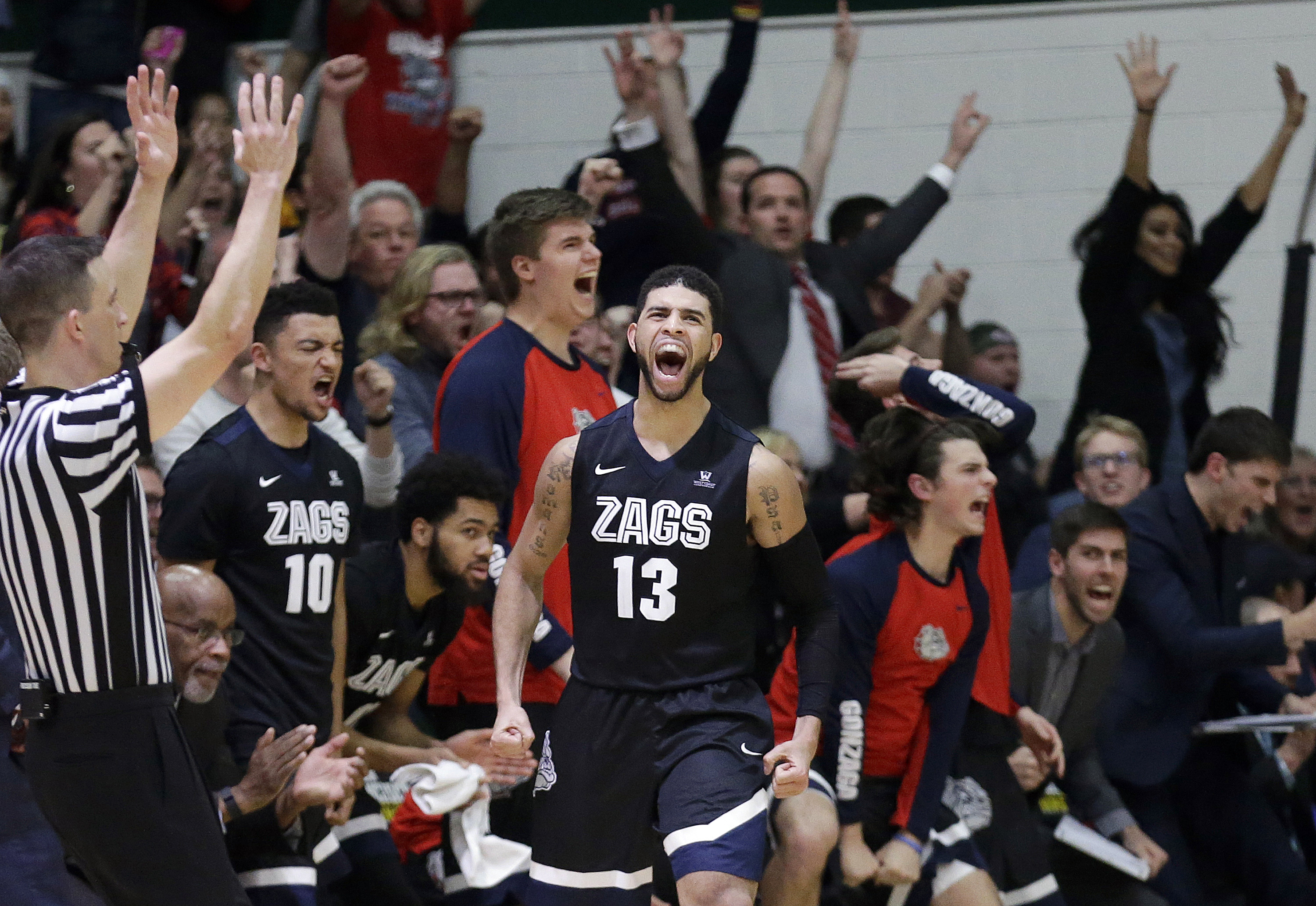 Gonzaga guard Josh Perkins (13) celebrates after making a 3-point basket against San Francisco during the second half of an NCAA college basketball game in San Francisco, Saturday, Jan. 2, 2016. Gonzaga won 102-94 in overtime. (AP Photo/Jeff Chiu)
