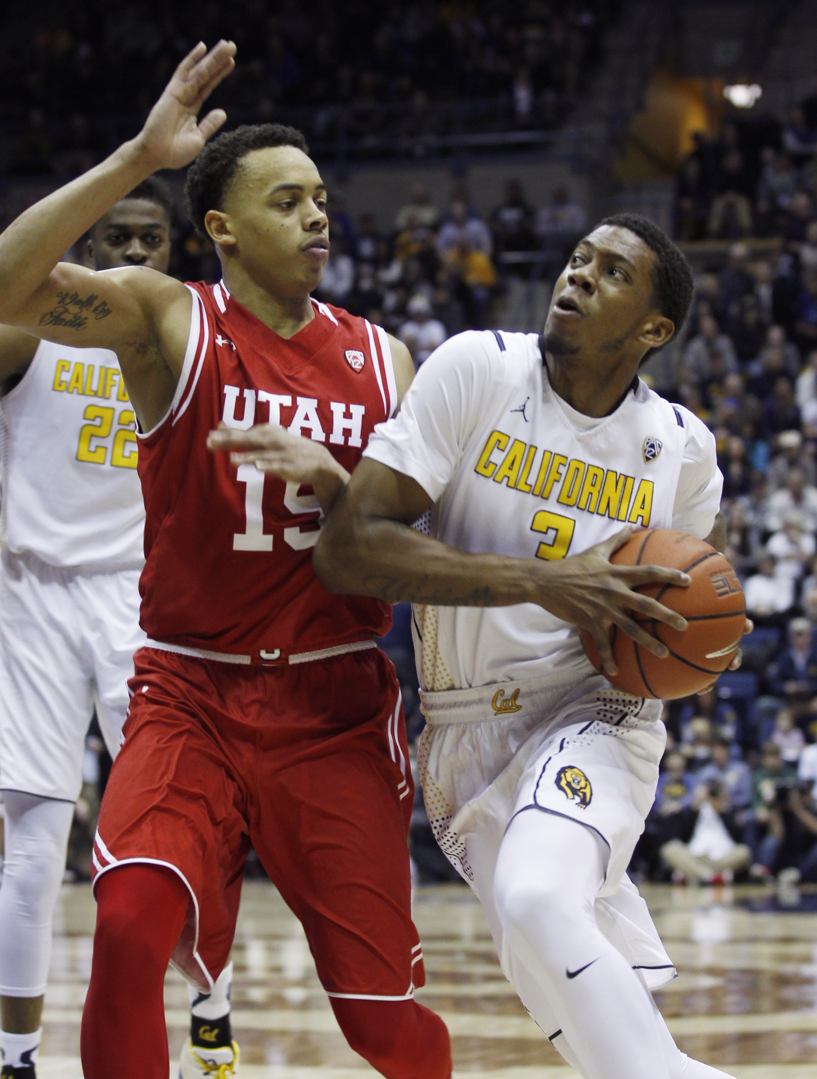 California Golden Bears' Tyrone Wallace, right, drives for the basket as Utah Utes' Lorenzo Bonham defends during the first half of an NCAA basketball game, Sunday, Jan. 3, 2016, in Berkeley, Calif. (AP Photo/George Nikitin)