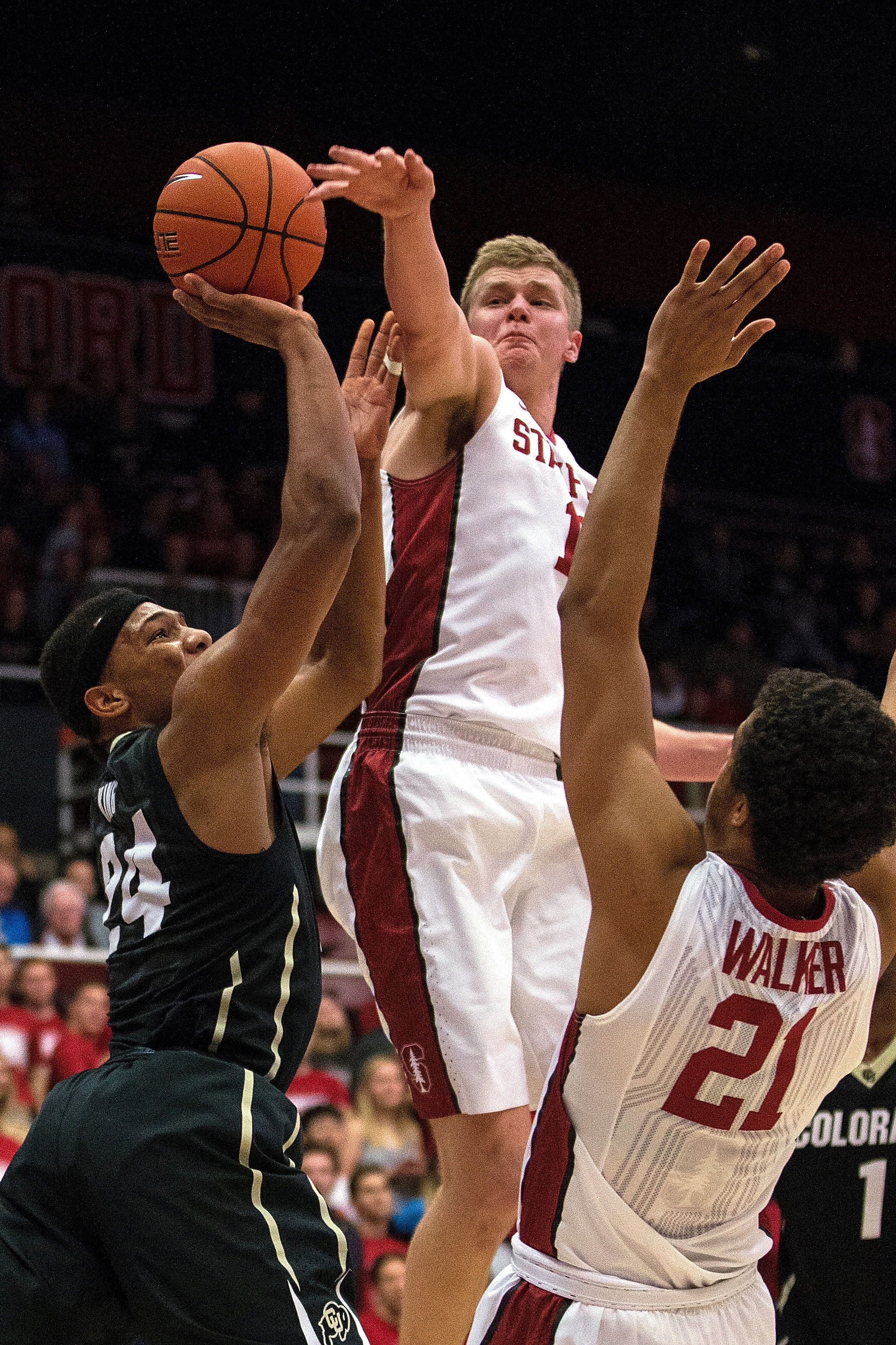 Colorado's George King, left, is defended by Stanford's Michael Humphrey, center, and Cameron Walker, left, during the first half of an NCAA college basketball game in Stanford, Calif., Sunday, Jan. 3, 2016. (AP Photo/Jason O. Watson)