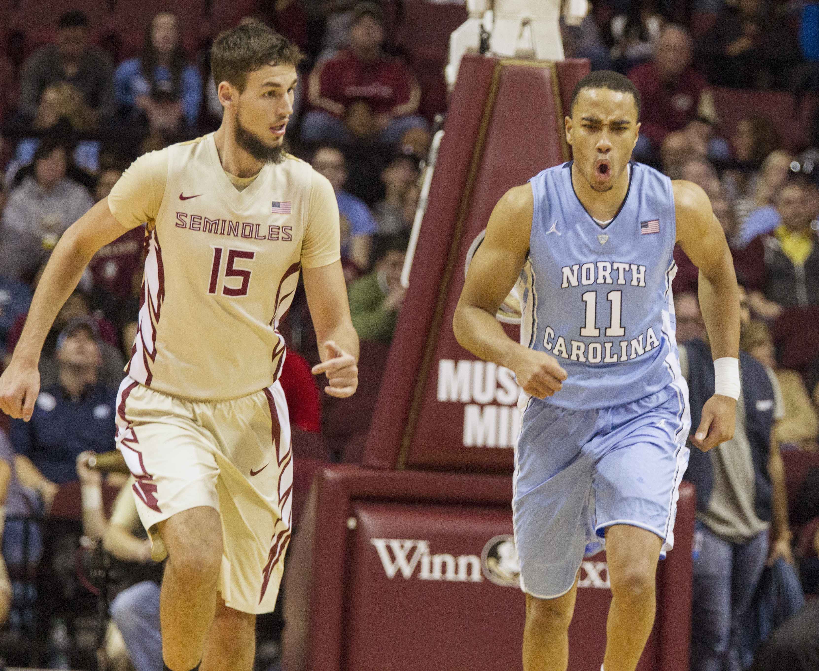 North Carolina forward Brice Johnson, right, reacts after dunking over Florida State center Boris Bojanovsky in the first half of an NCAA college basketball game in Tallahassee, Fla., Monday, Jan. 4, 2016. (AP Photo/Mark Wallheiser)