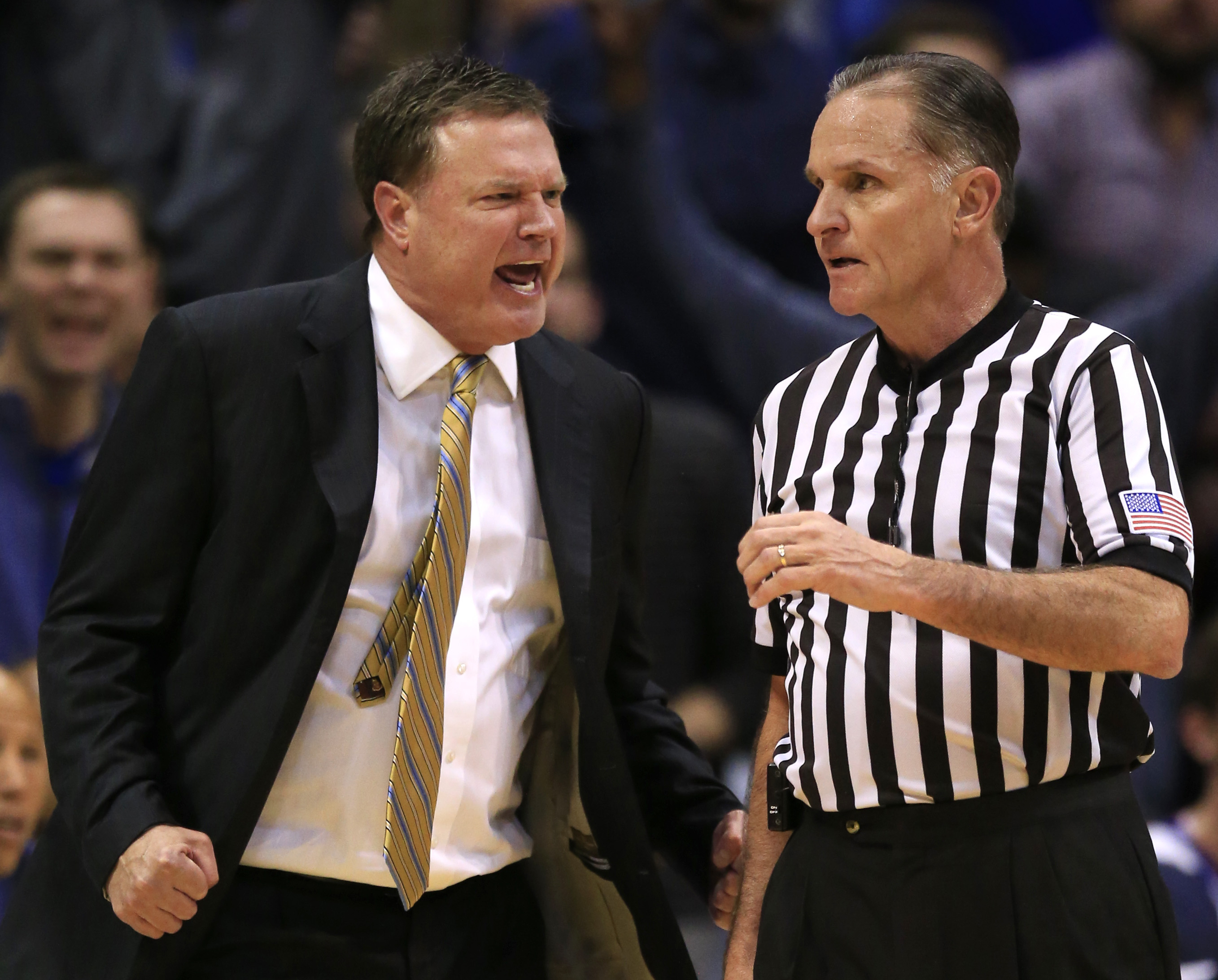 Kansas head coach Bill Self, left, objects to a call by referee Kelly Self, right, during the first half of an NCAA college basketball game in Lawrence, Kan., Monday, Jan. 4, 2016. (AP Photo/Orlin Wagner)