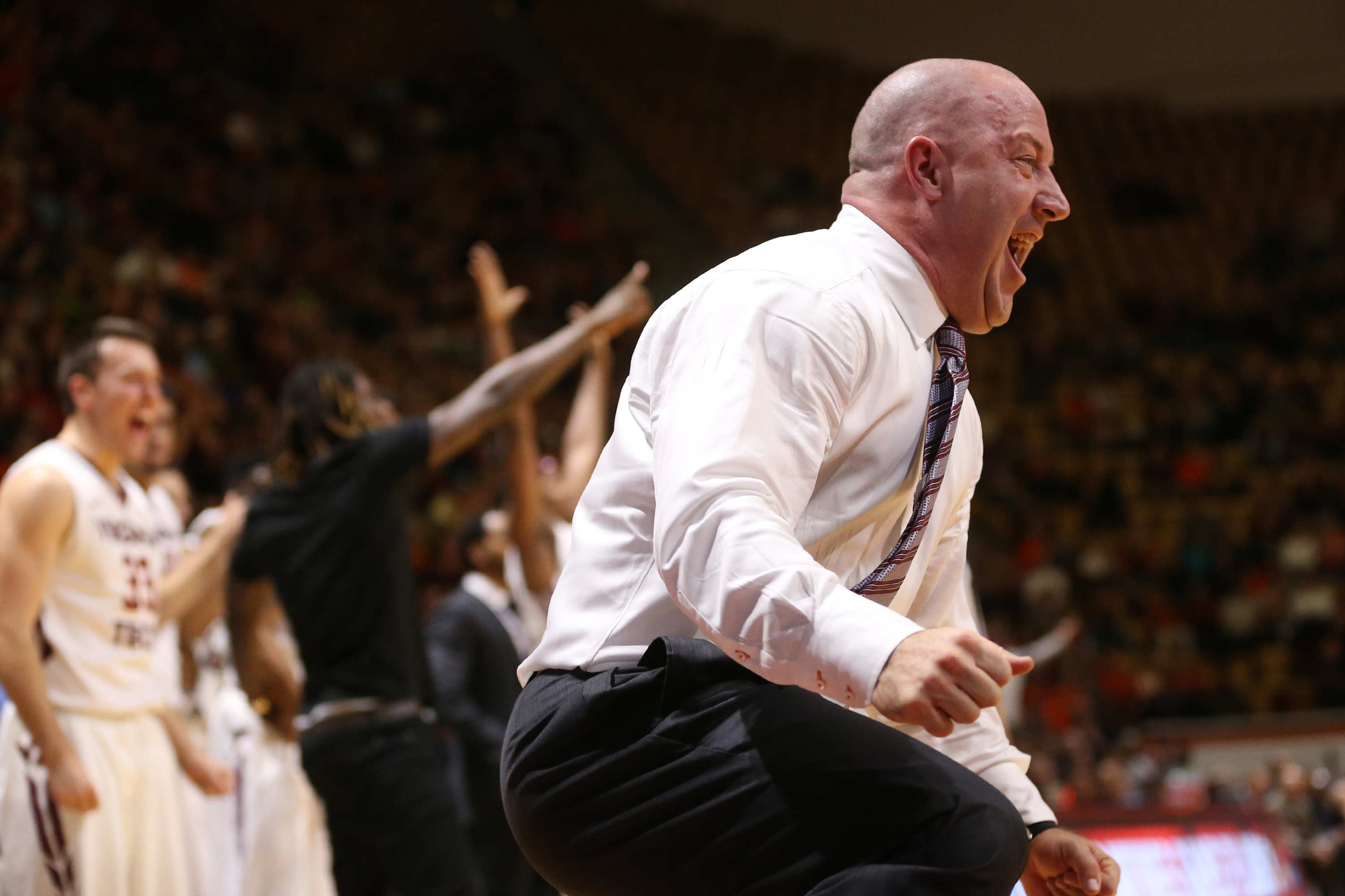 Virginia Tech head coach Buzz Williams celebrates a play in the first half of an NCAA college basketball game against Virginia, Monday, Jan. 4, 2016, in Blacksburg, Va. (Matt Gentry/The Roanoke Times via AP) LOCAL STATIONS OUT; LOCAL INTERNET OUT; LOCAL P