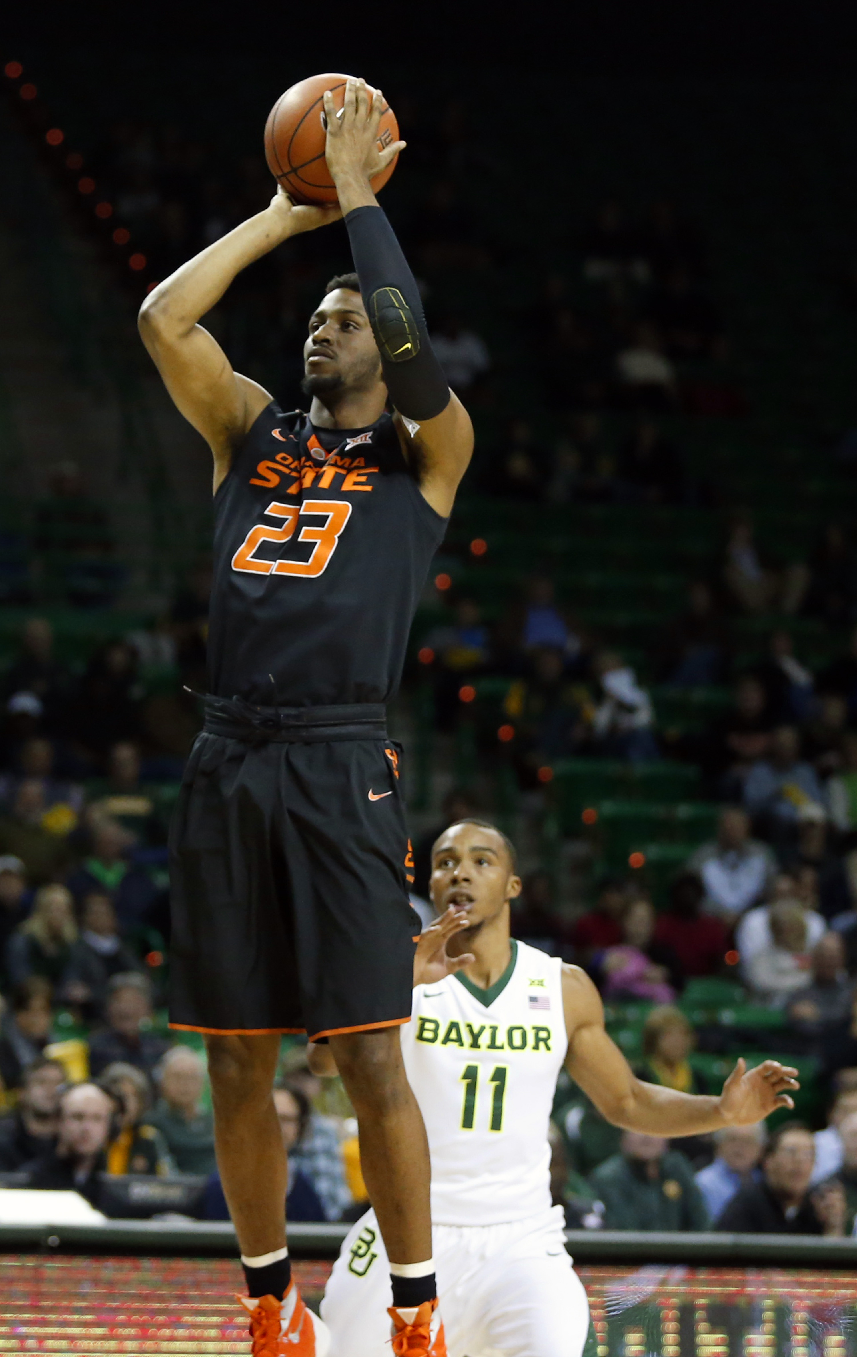 Oklahoma State Leyton Hammonds (23) scores over Baylor guard Lester Medford (11) in the first half of an NCAA college basketball game, Tuesday, Jan. 5, 2016, in Waco, Texas. (Rod Aydelotte/Waco Tribune Herald, via AP)