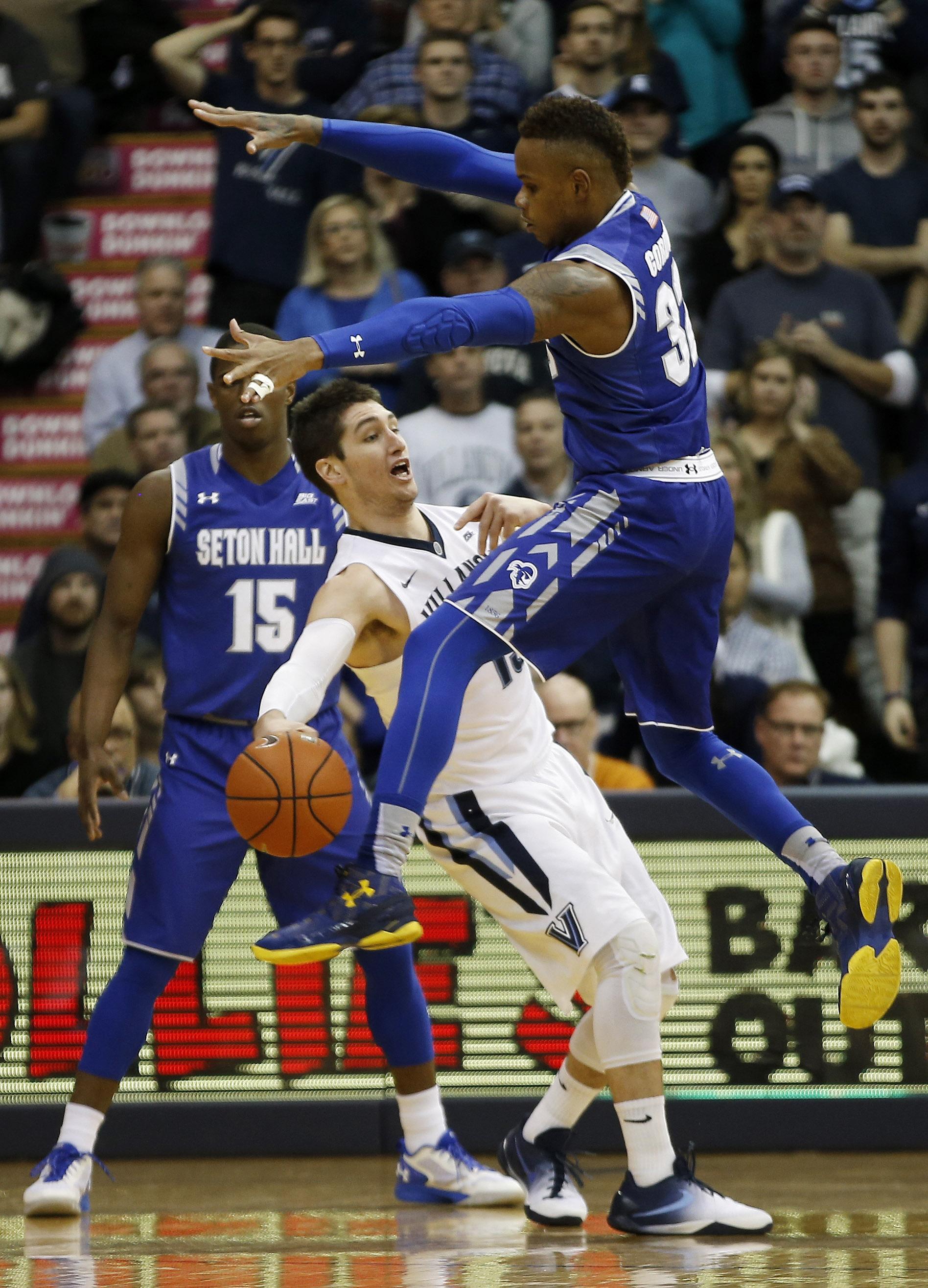 Seton Hall's Angel Delgado, right, tries to block a pass by Villanova's Ryan Arcidiacono during the first half of an NCAA college basketball game, Wednesday, Jan. 6, 2016, in Villanova, Pa. (AP Photo/Matt Slocum)