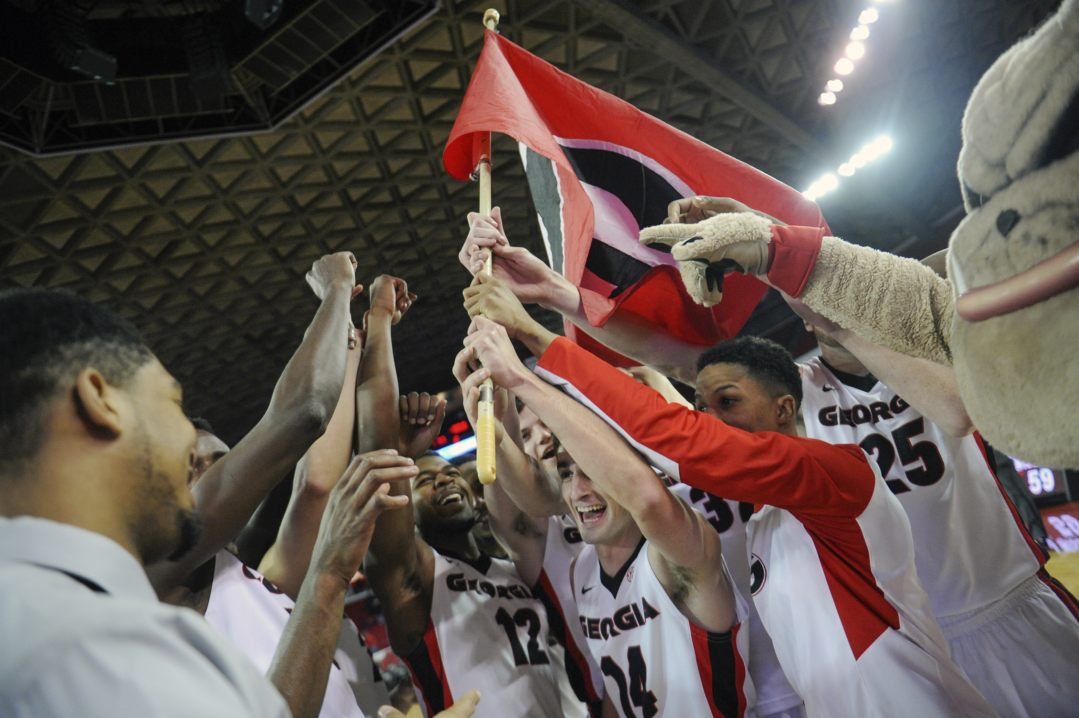 Georgia players celebrate after the second half of an NCAA college basketball game between Georgia and Missouri on Wednesday, Jan. 6, 2016, in Athens, Ga. (AJ Reynolds/Athens Banner-Herald via AP) MAGS OUT; MANDATORY CREDIT