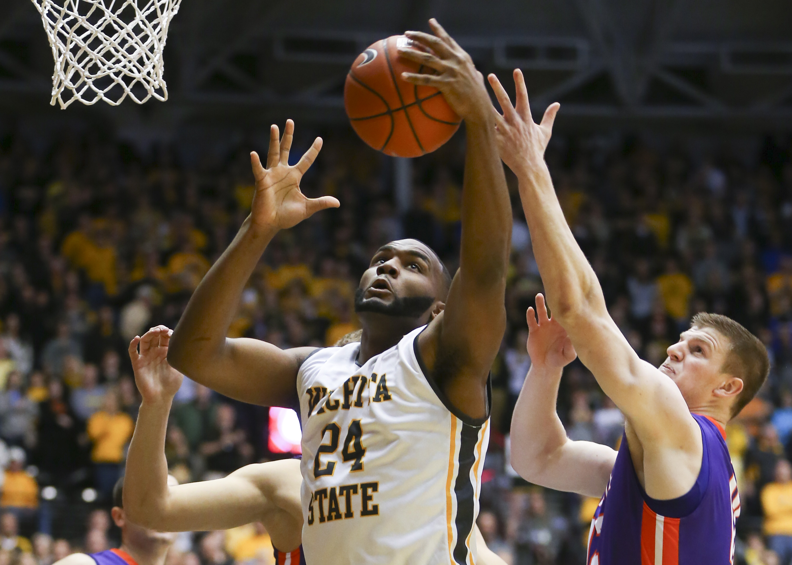 Wichita State forward Shaquille Morris grabs a rebound against Evansville guard Adam Wing during the first half of an NCAA college basketball game on Wednesday, Jan. 6. 2016 in Wichita, Kan. (Travis Heying/The Wichita Eagle via AP)