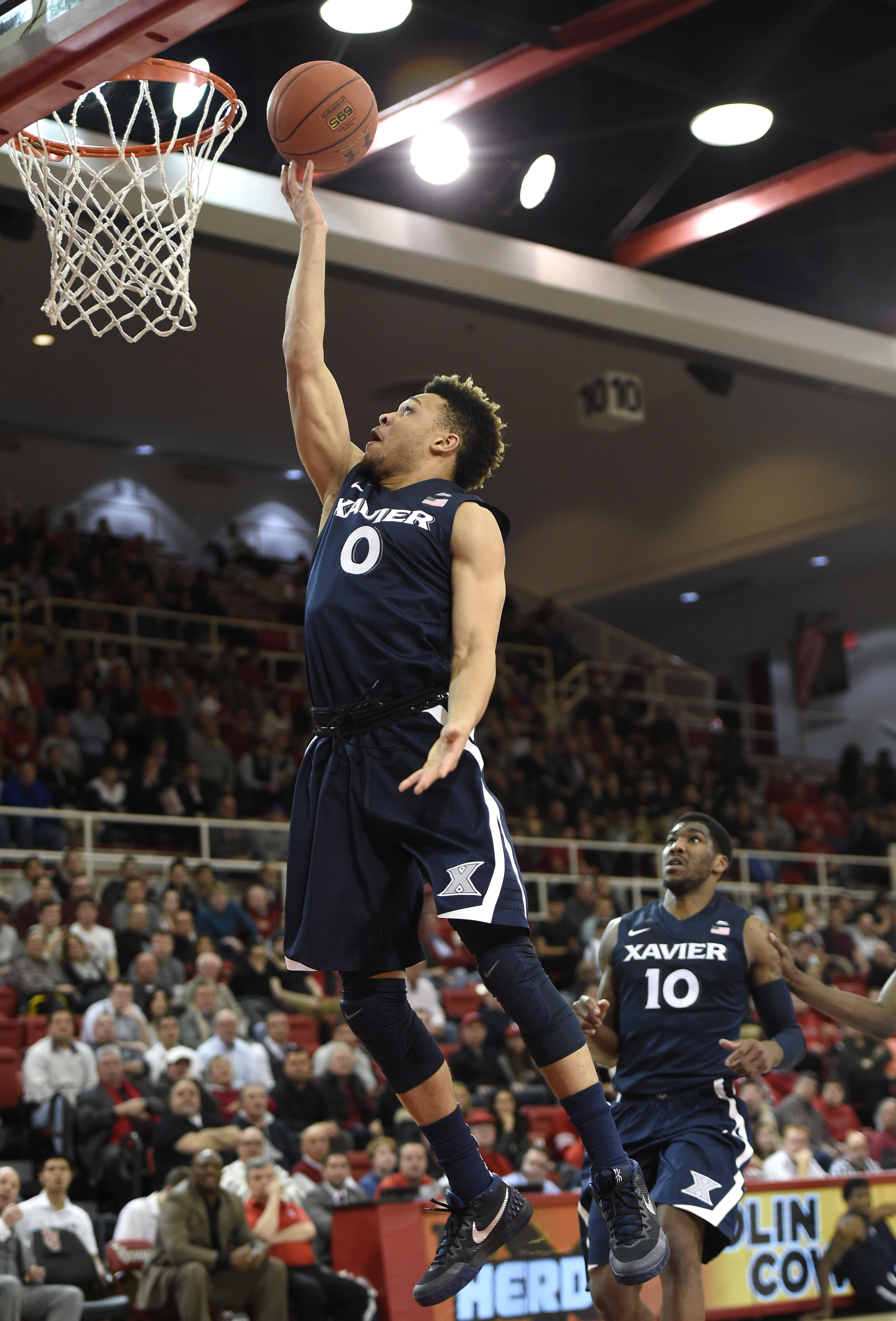 Xavier's guard Larry Austin Jr. (0) drives the ball to the basket as guard Remy Abell (10) looks for the rebound during the first half of an NCAA college basketball game against St. John's on Wednesday, Jan. 6, 2016 in New York. (AP Photo/Kathy Kmonicek)