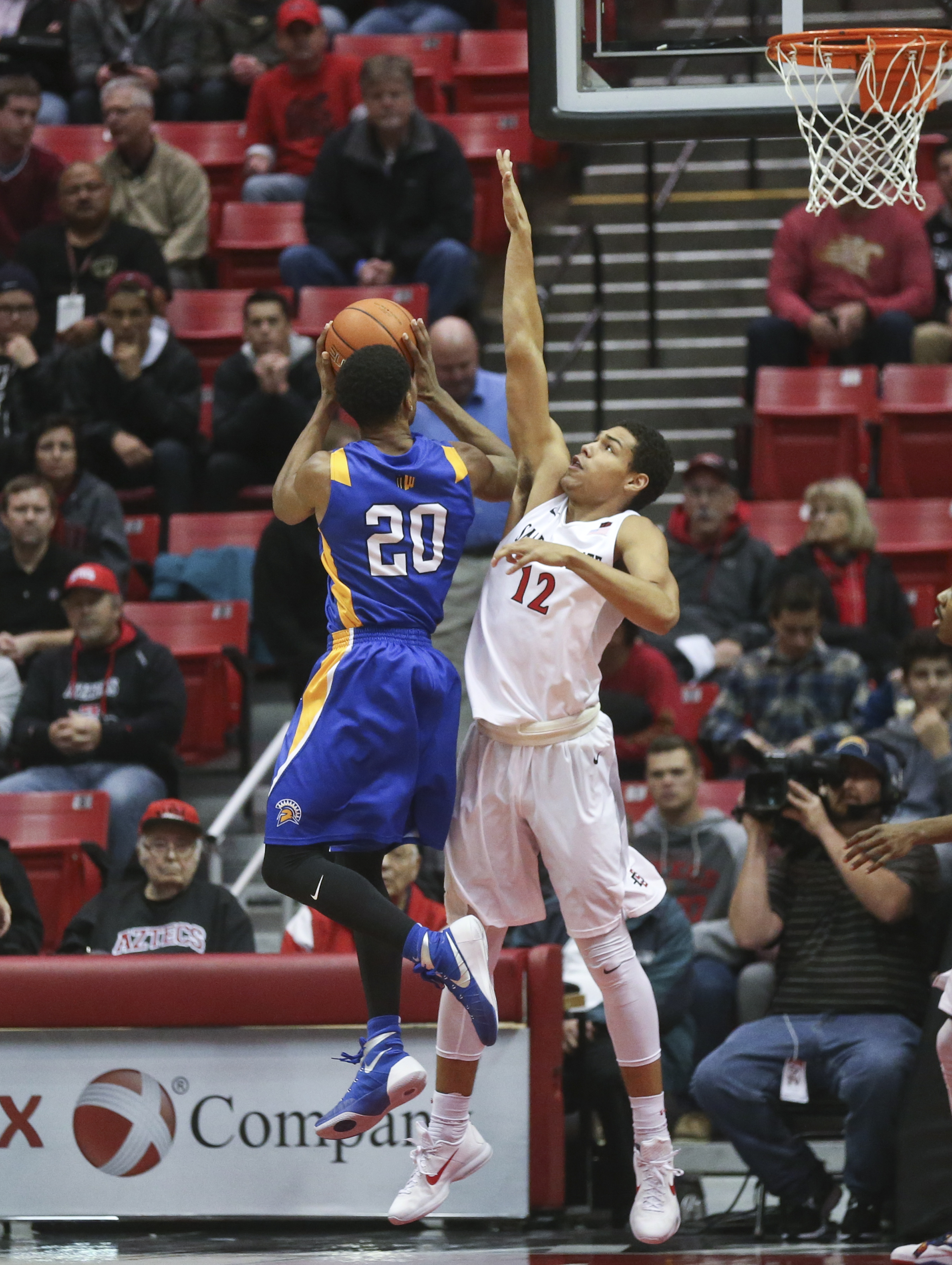 San Diego State guard Trey Kell gets enough of San Jose State guard Isaac Thornton to disrupt his shot attempt during the first half of a NCAA college basketball game Wednesday, Jan. 6, 2016, in San Diego.  (AP Photo/Lenny Ignelzi)
