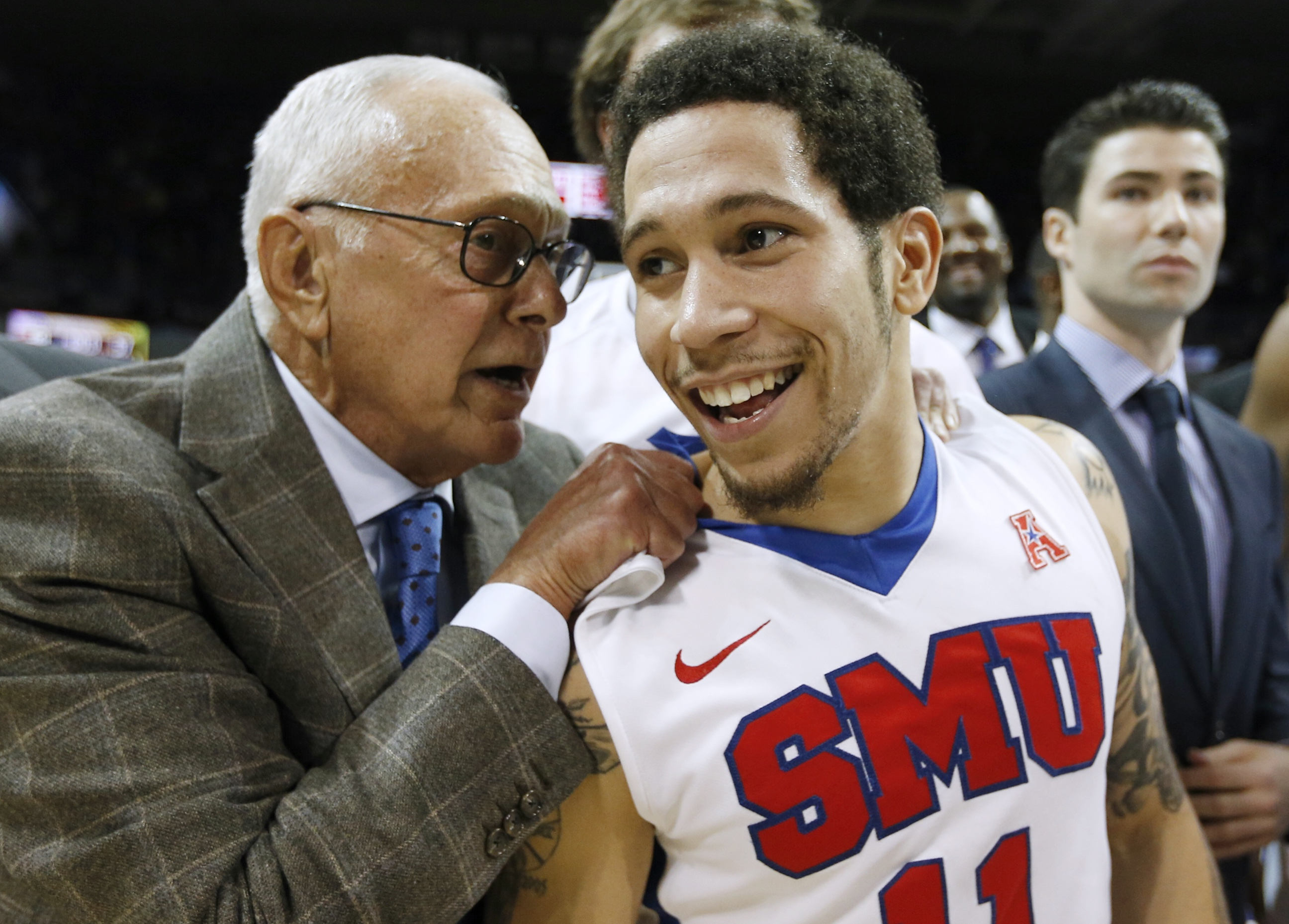SMU coach Larry Brown celebrates with guard Nic Moore (11) the team's  59-57 win over Cincinnati in an NCAA college basketball game Thursday, Jan. 7, 2016, in Dallas. (AP Photo/Brandon Wade)