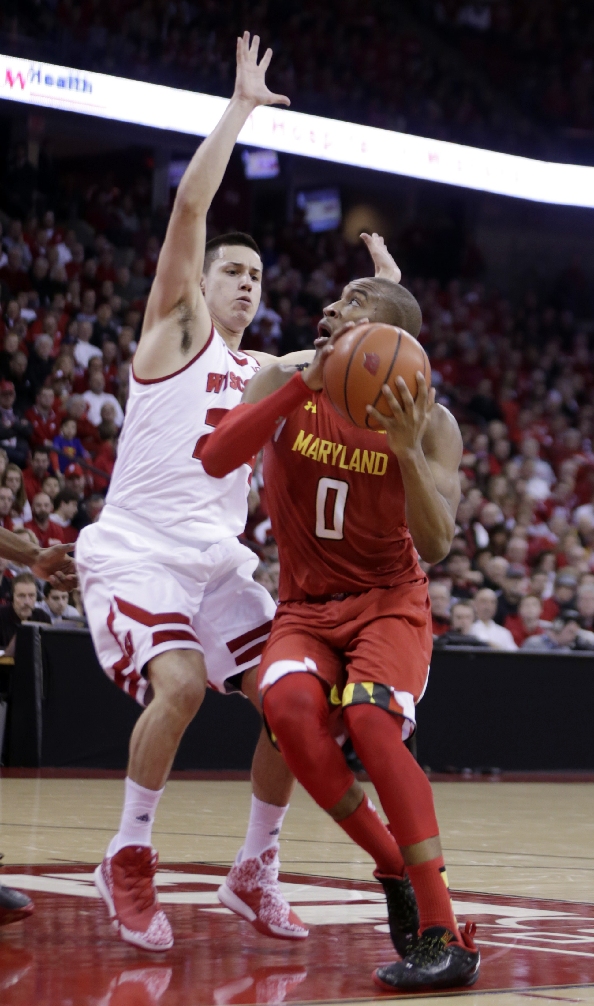 Maryland's Rasheed Sulaimon (0) looks to shoot against Wisconsin's Bronson Koenig (24) during the first half of an NCAA college basketball game, Saturday, Jan. 9, 2016, in Madison, Wis. (AP Photo/Andy Manis)