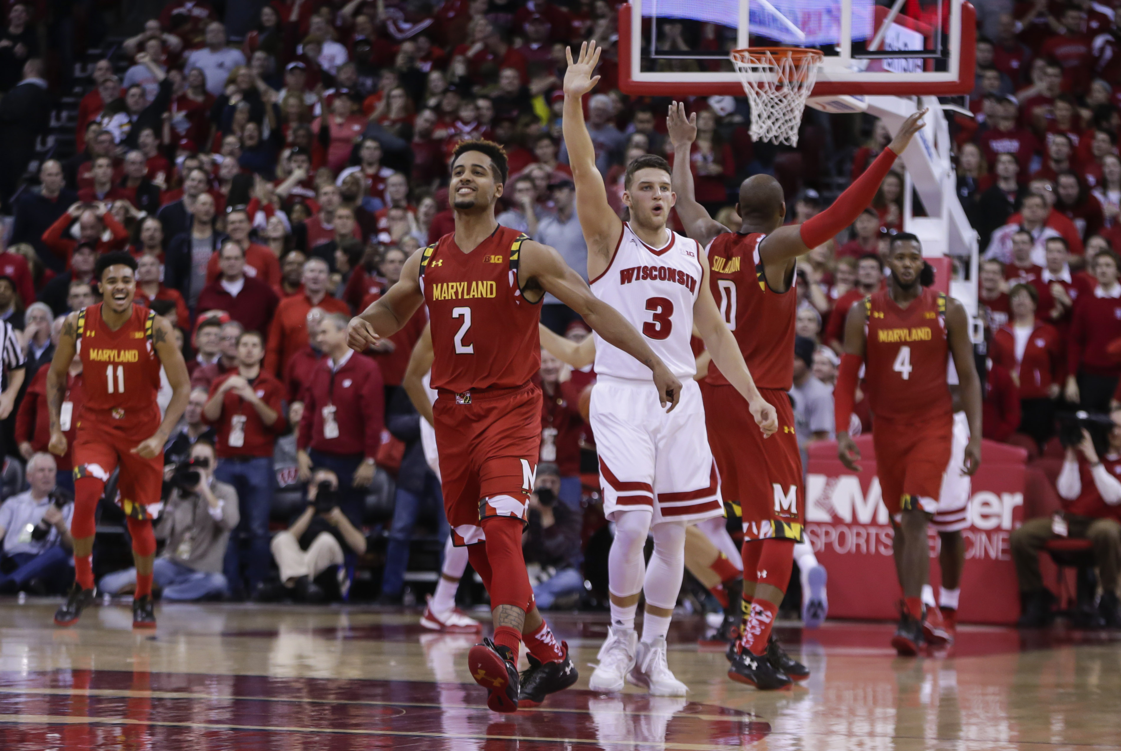 Maryland's Melo Trimble (2) reacts after hitting the game-winning basket against Wisconsin in the final seconds of an NCAA college basketball game Saturday, Jan. 9, 2016, in Madison, Wis. Maryland won 63-60. (AP Photo/Andy Manis)