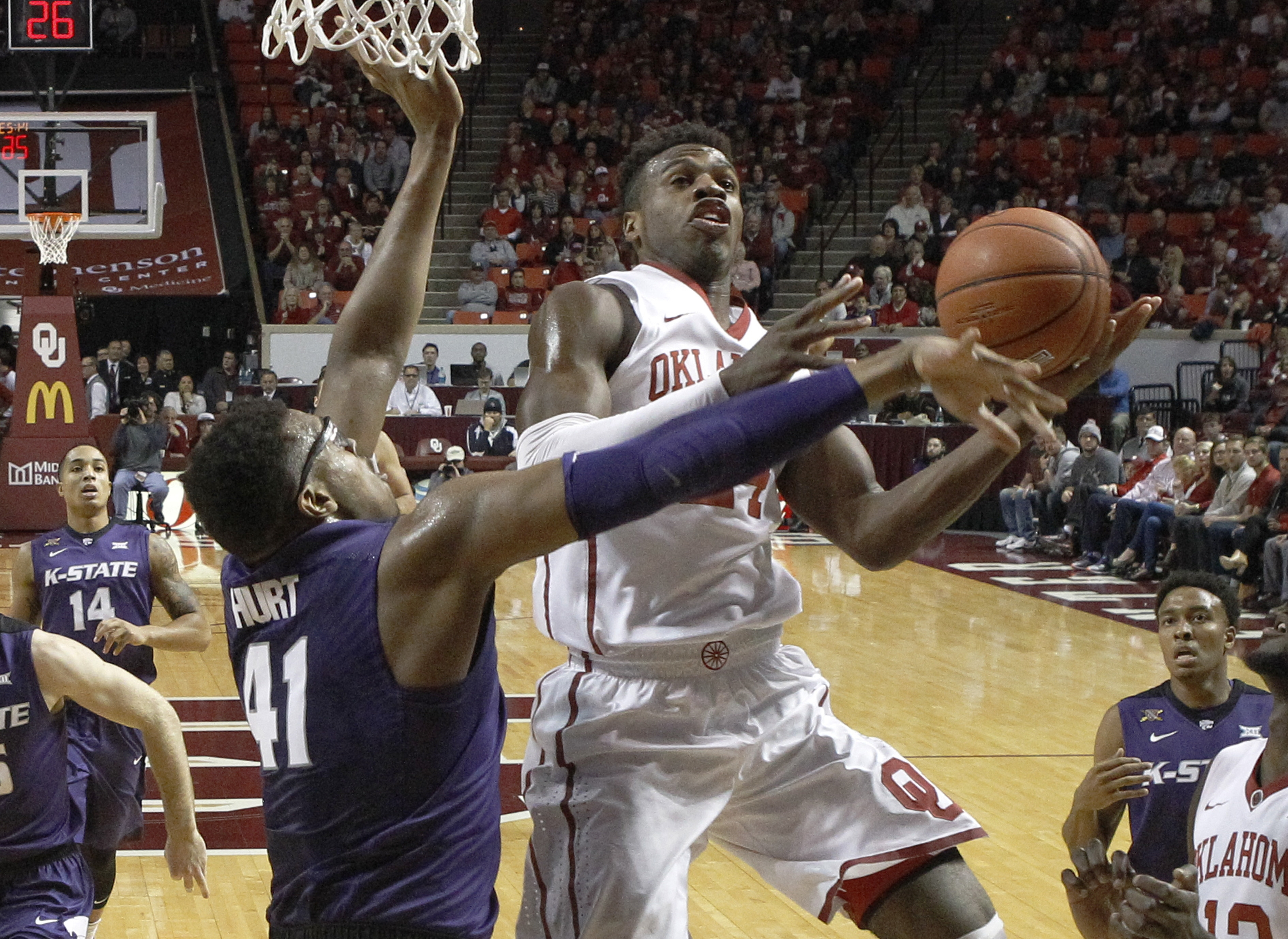 Oklahoma guard Buddy Hield, front right, goes up to shoot defended by Kansas State forward Stephen Hurt (41) in the first half of an NCAA college basketball game in Norman, Okla., Saturday, Jan. 9, 2016. (AP Photo/Sue Ogrocki)