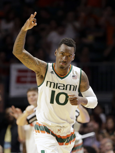 Miami guard Sheldon McClellan (10) celebrates after scoring a 3-point basket against Florida State during the second half of an NCAA college basketball game, Saturday, Jan. 9, 2016, in Coral Gables, Fla. Miami won 72-59. (AP Photo/Alan Diaz)