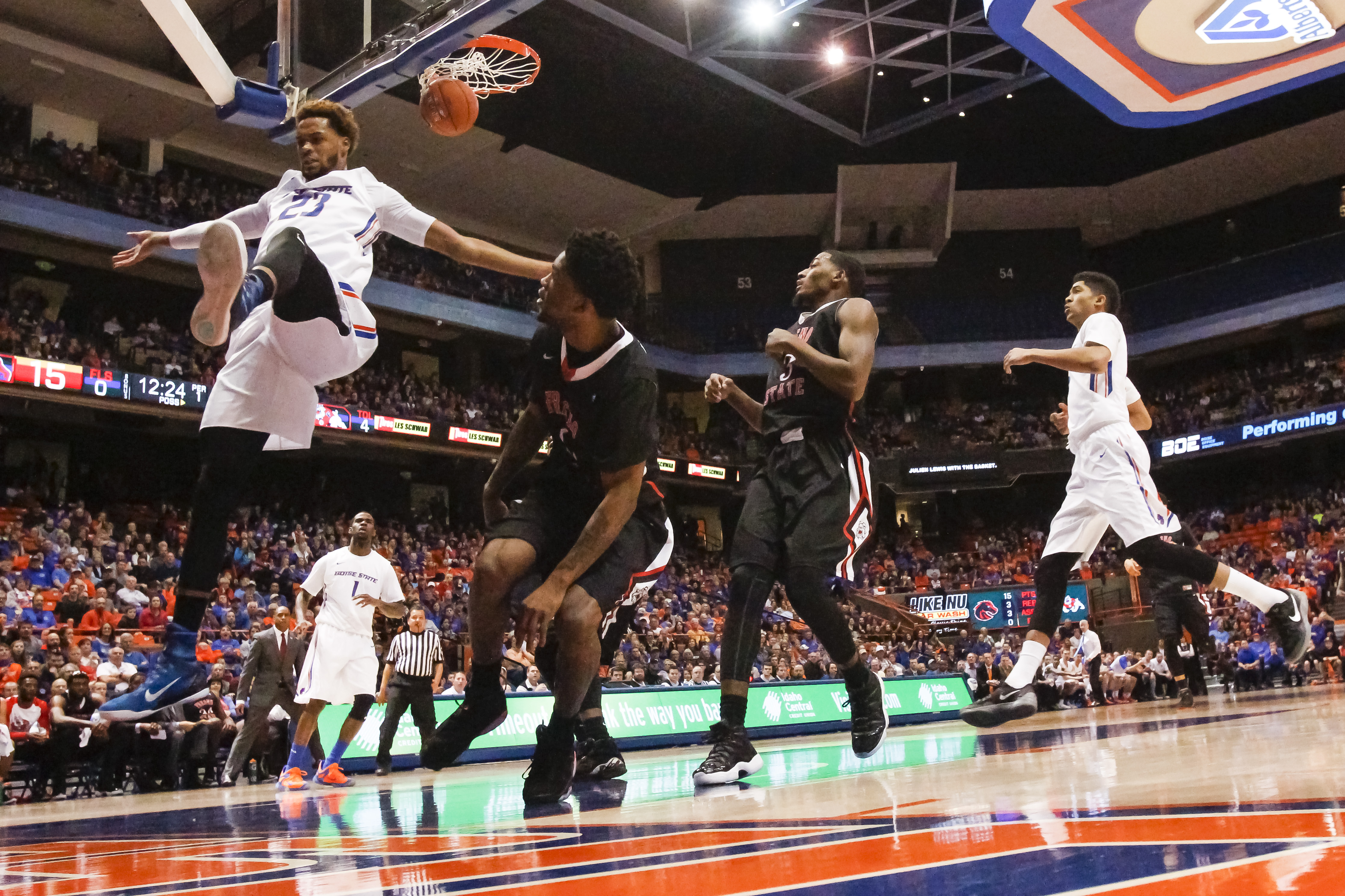 Boise State's James Webb III comes down from a dunk during the first half of an NCAA college basketball game against Fresno State in Boise, Idaho, on Saturday, Jan. 9, 2016. Boise State won 81-70. (AP Photo/Otto Kitsinger)