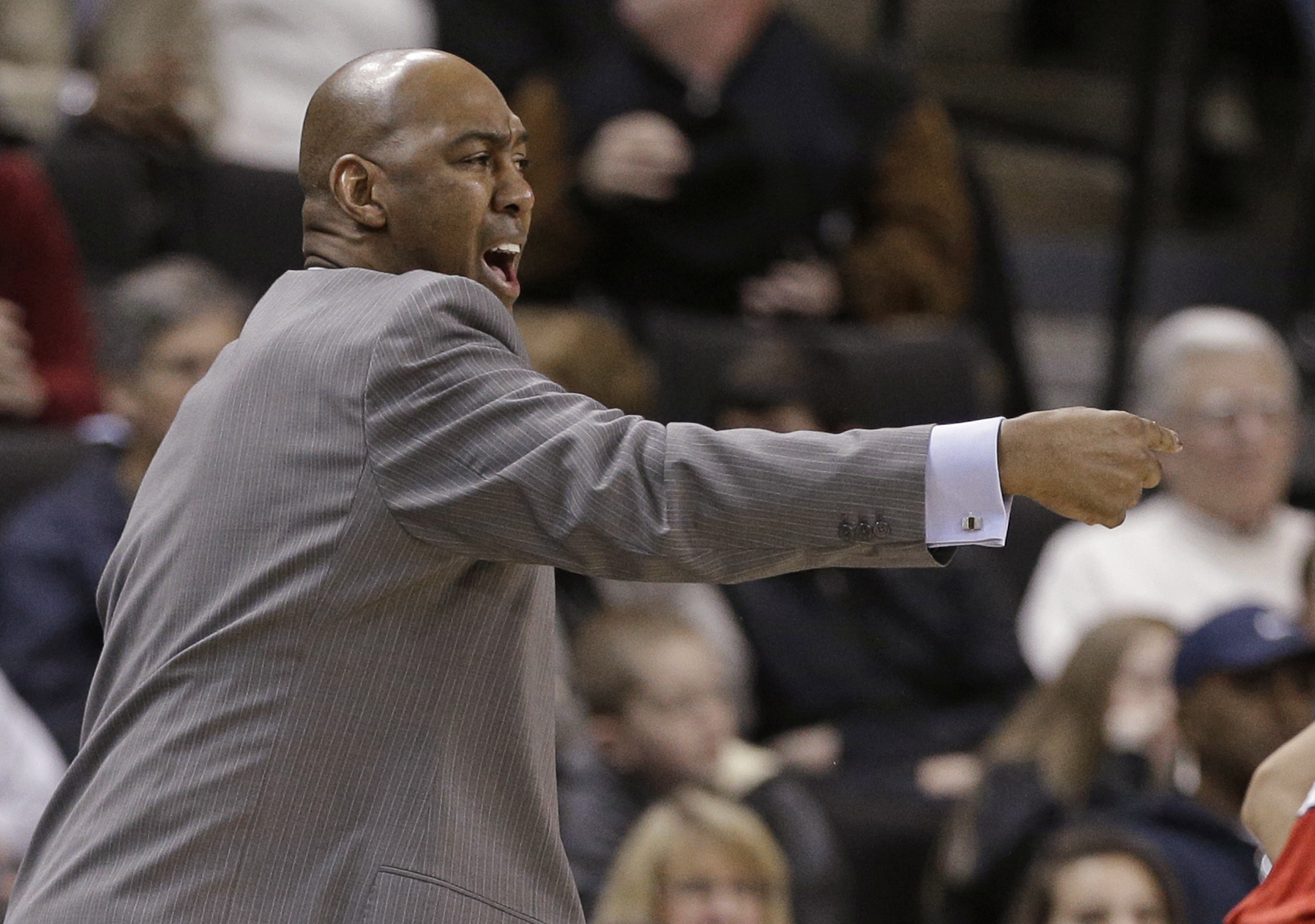 Wake Forest coach Danny Manning directs his team against North Carolina State during the first half of an NCAA college basketball game in Winston-Salem, N.C., Sunday, Jan. 10, 2016. (AP Photo/Chuck Burton)