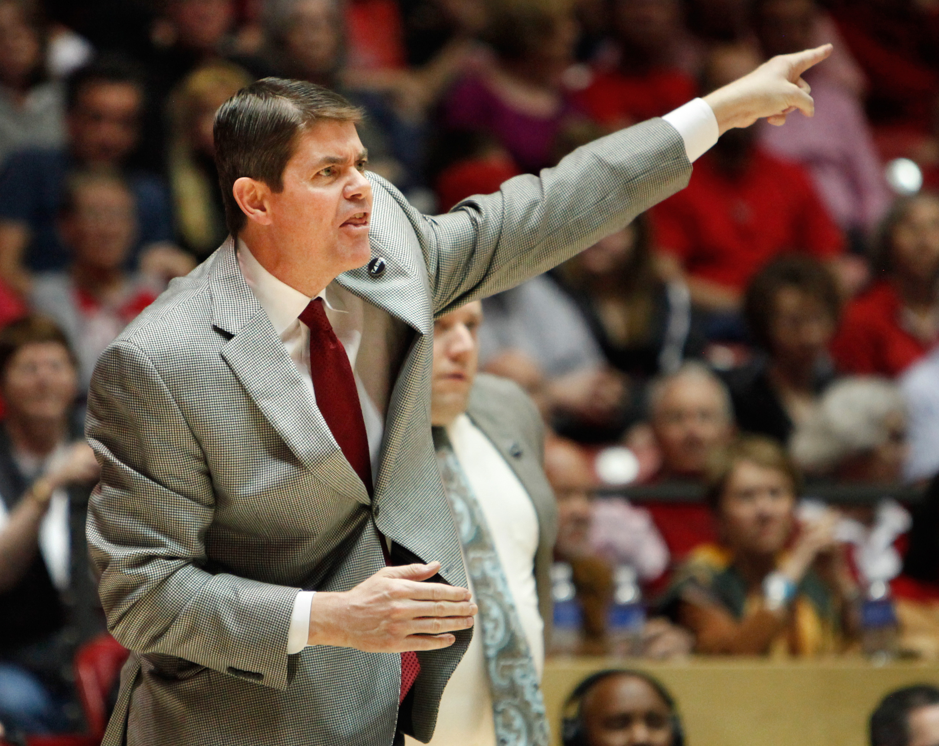 FILE - In this Feb. 21, 2015, file photo, UNLV coach Dave Rice calls a play during his team's NCAA college basketball game against New Mexico in Albuquerque, N.M. Rice has resigned in the middle of his fifth season after the struggling Runnin' Rebels open