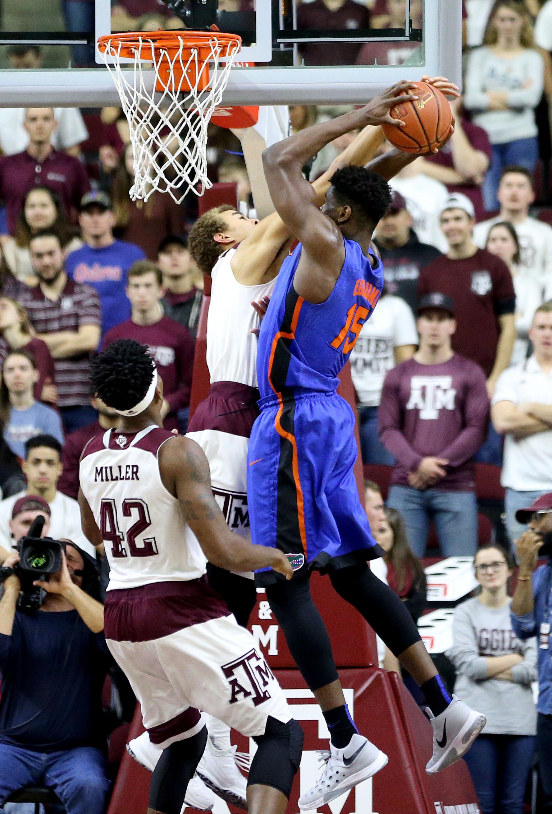 Texas A&M's D.J. Hogg (1) blocks a shot by Florida's John Egbunu (15) during the first half of an NCAA college basketball game, Tuesday, Jan. 12, 2016, in College Station, Texas. (AP Photo/Sam Craft)