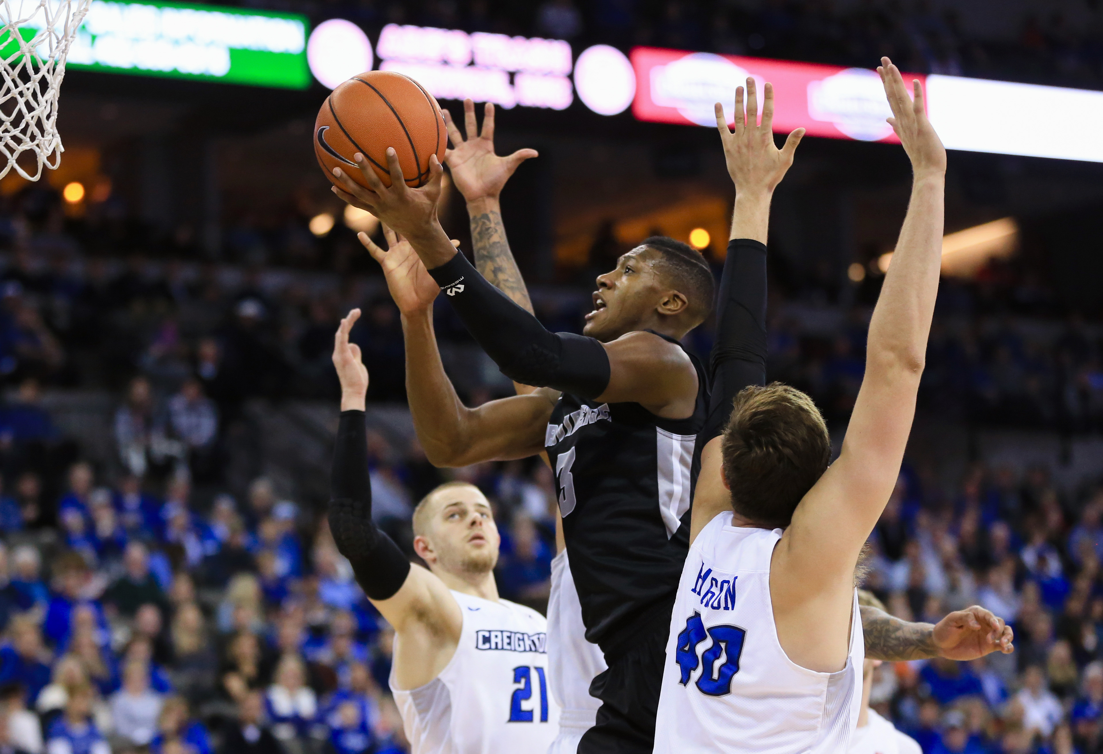 Providence's Kris Dunn (3) goes to the basket between Creighton's Isaiah Zierden (21) and Zach Hanson (40) during the first half of an NCAA college basketball game in Omaha, Neb., Tuesday, Jan. 12, 2016. (AP Photo/Nati Harnik)