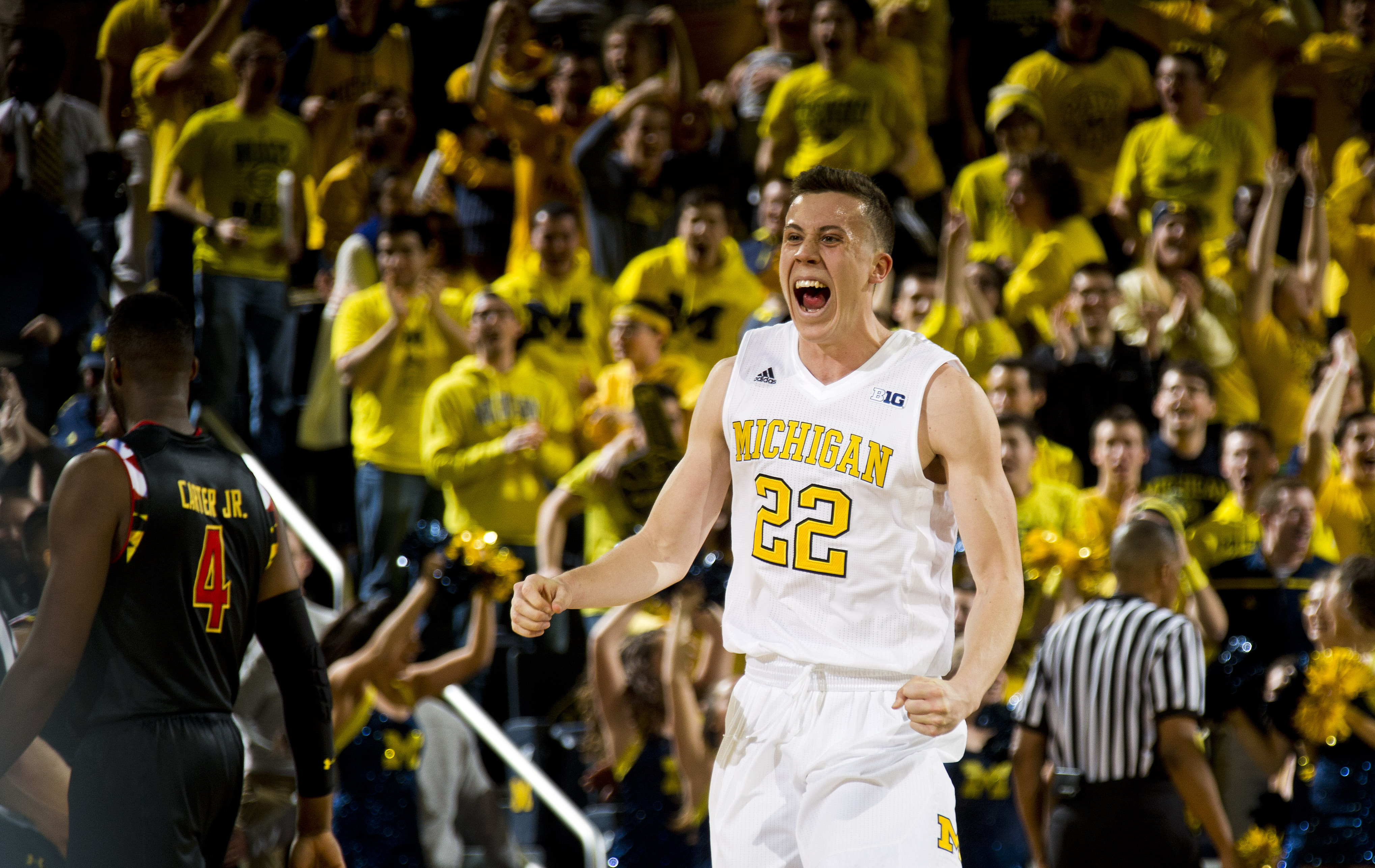Michigan guard Duncan Robinson (22) celebrates after the final seconds of an NCAA college basketball game against Maryland at Crisler Center in Ann Arbor, Mich., Tuesday, Jan. 12, 2016. Michigan won 70-67. (AP Photo/Tony Ding)